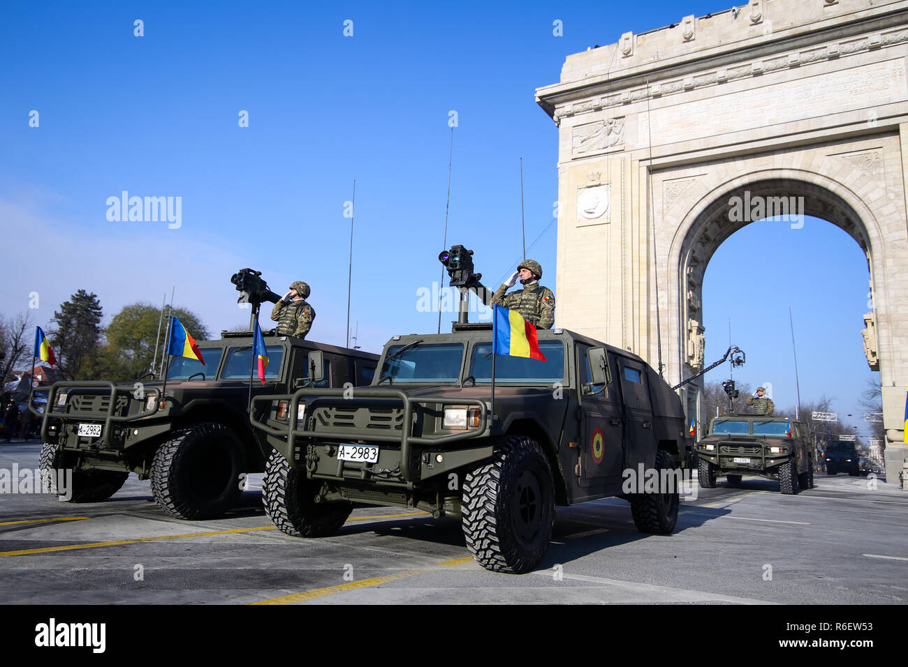 BUCHAREST, ROMANIA - December 1, 2018: URO VAMTAC combat armored vehicles, at Romanian National Day military parade pass under the Arch of Triumph - Stock Image