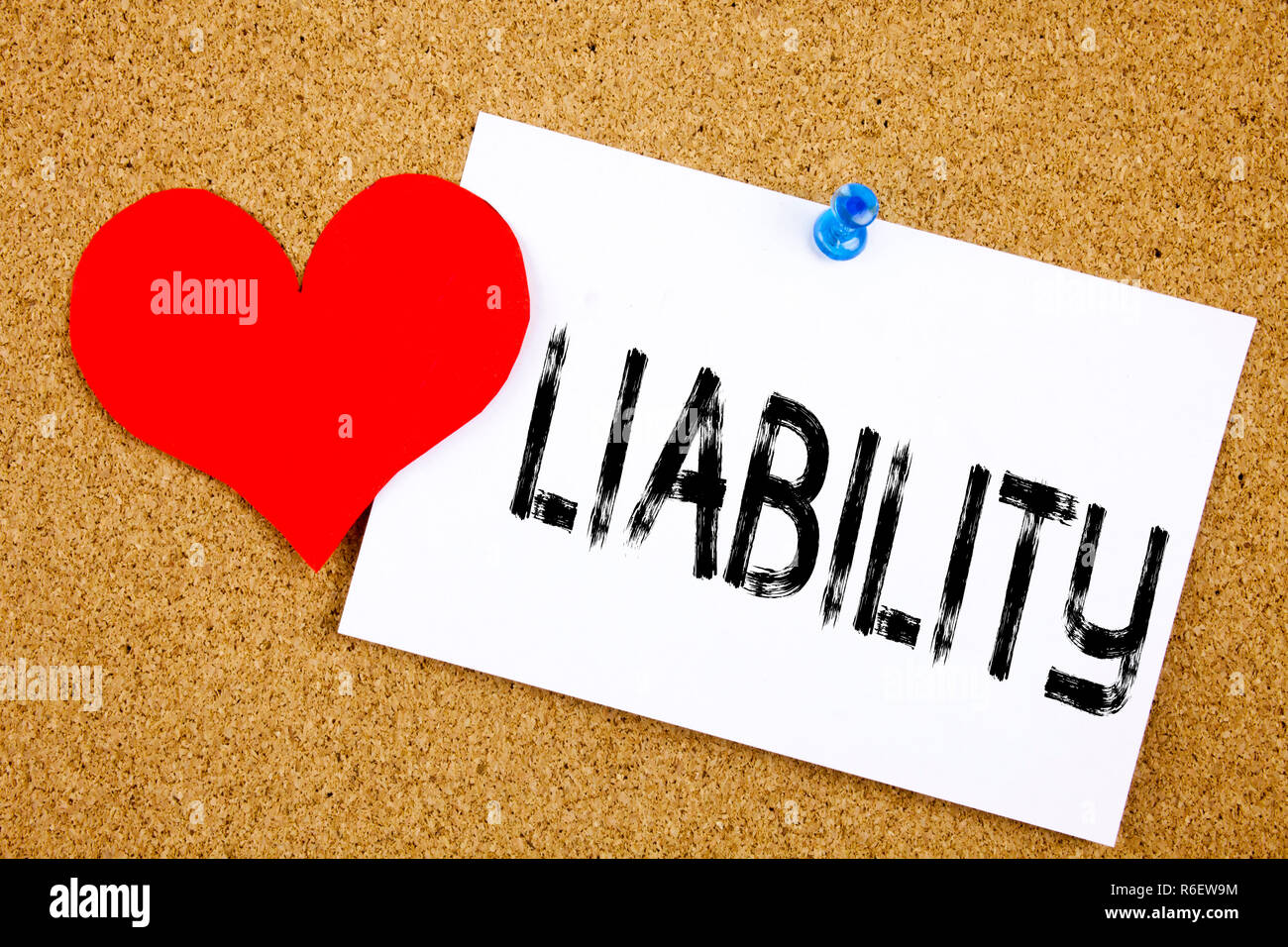 Conceptual hand writing text caption inspiration showing Liability concept for Accountability Legal Blame Risk and Love written on sticky note, reminder cork background with copy space - Stock Image