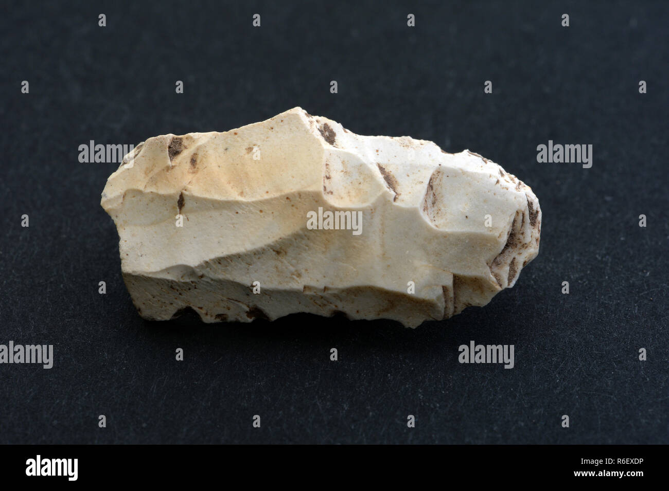 Shaped flint from Gower Peninsula in south Wales used by early paleolithic people. Flint does not occur locally so this is evidence of early traders Stock Photo