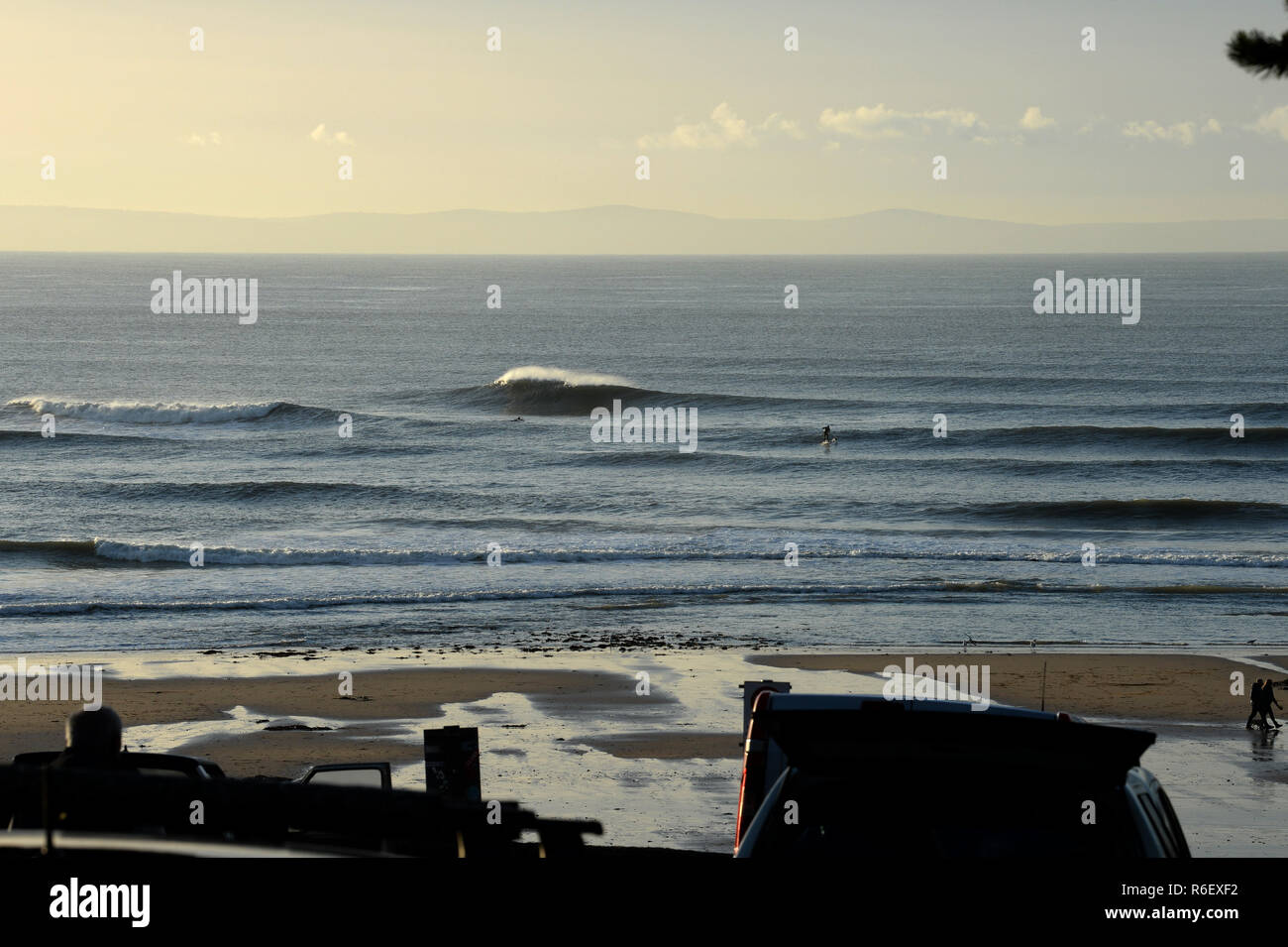 Classic offshore waves roll into the bay at Langland with the 'sand bar' pitching well overhead Stock Photo