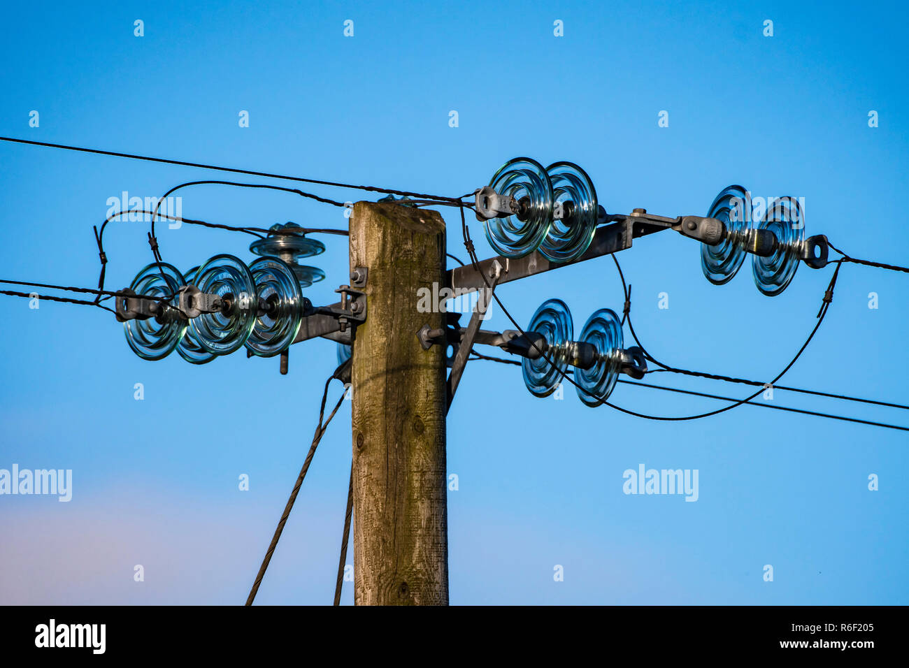 Electrical pole, with glass insulators. Stock Photo