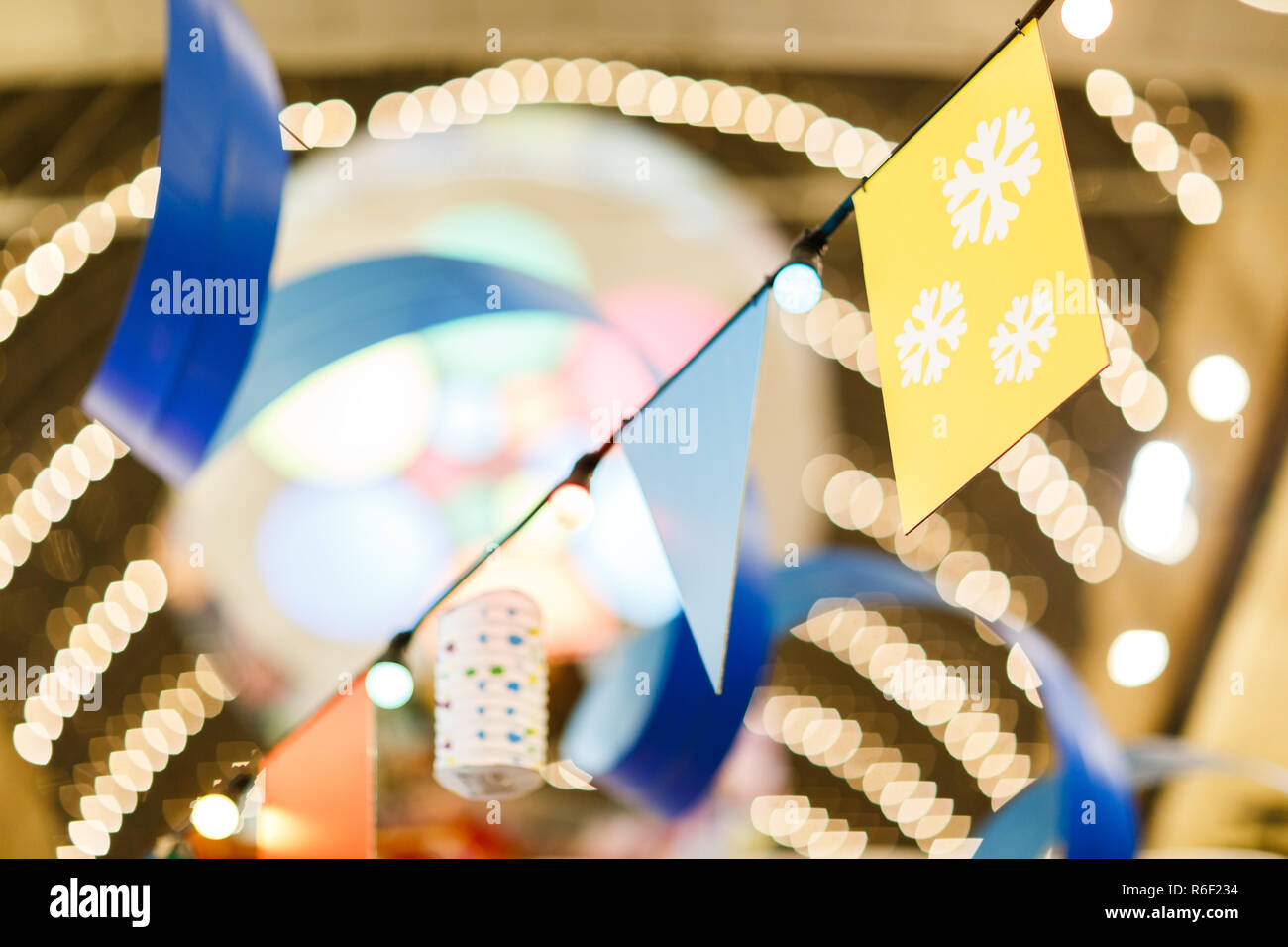 Photo of Christmas flags on blurred background Stock Photo