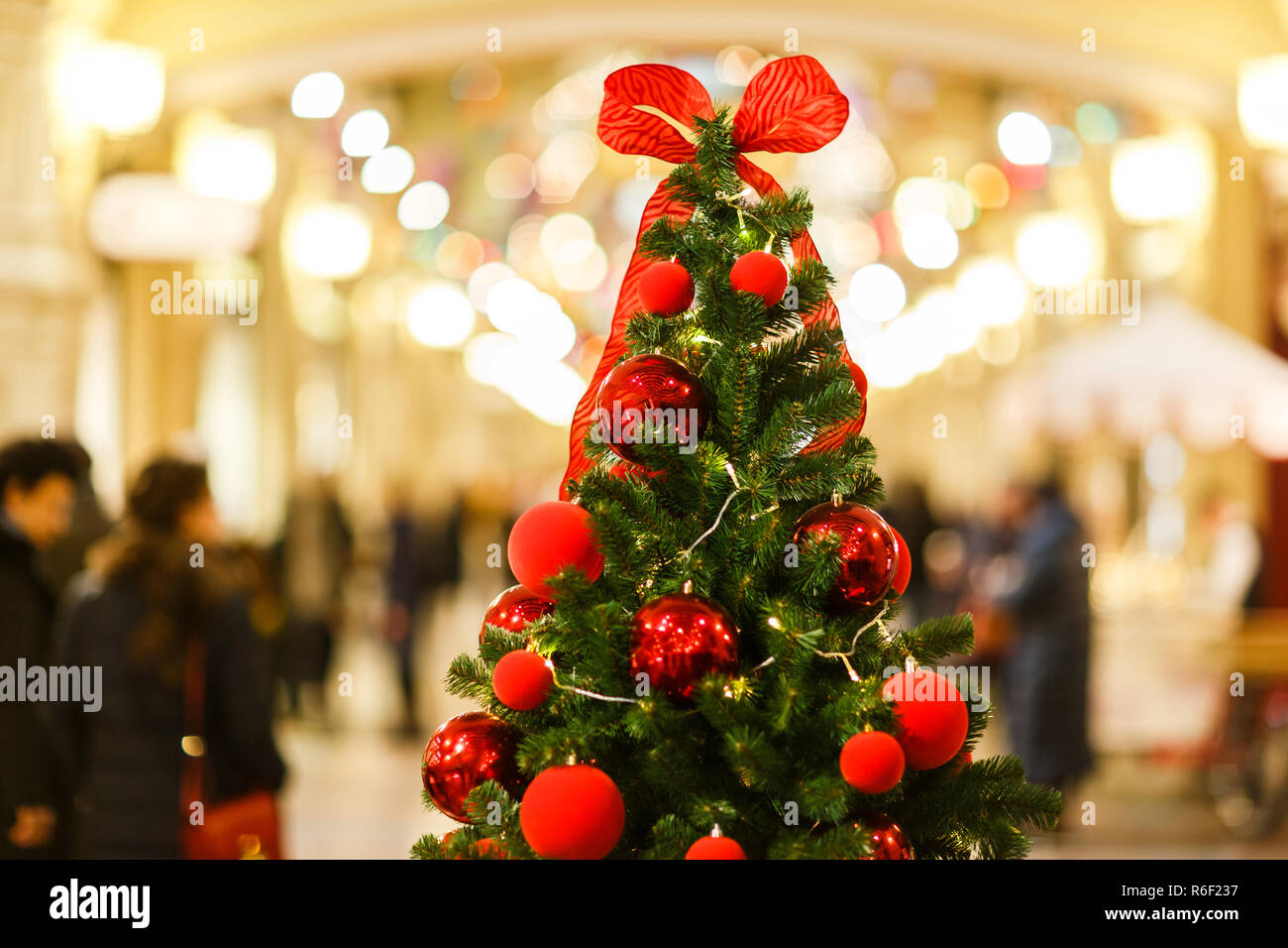Photo of Christmas tree with red balls on blurred background. - Stock Image