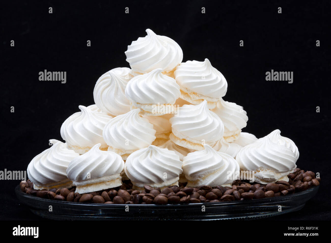 French vanilla meringue cookies and coffee beans - Stock Image