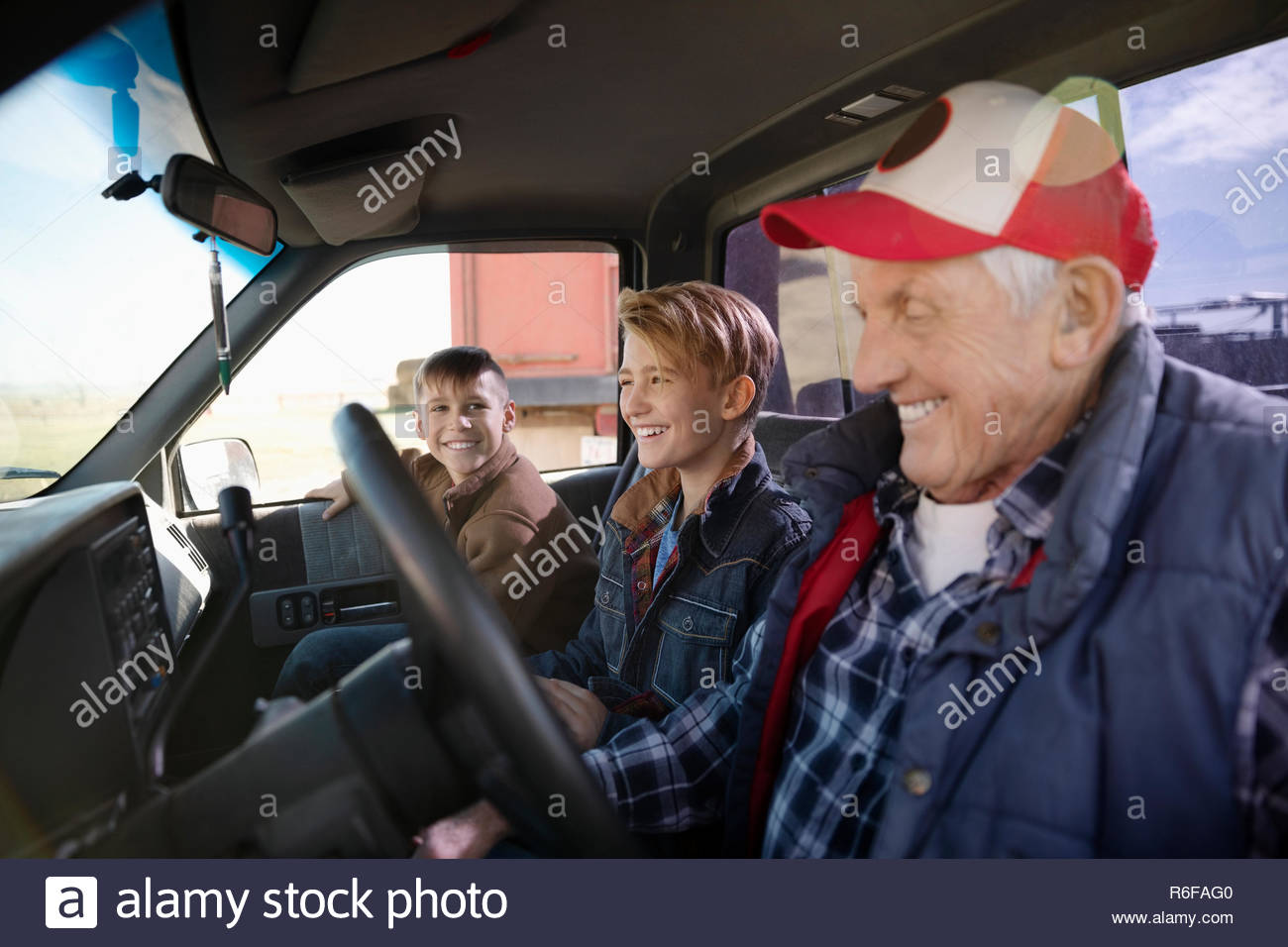 Grandfather and grandsons in truck - Stock Image