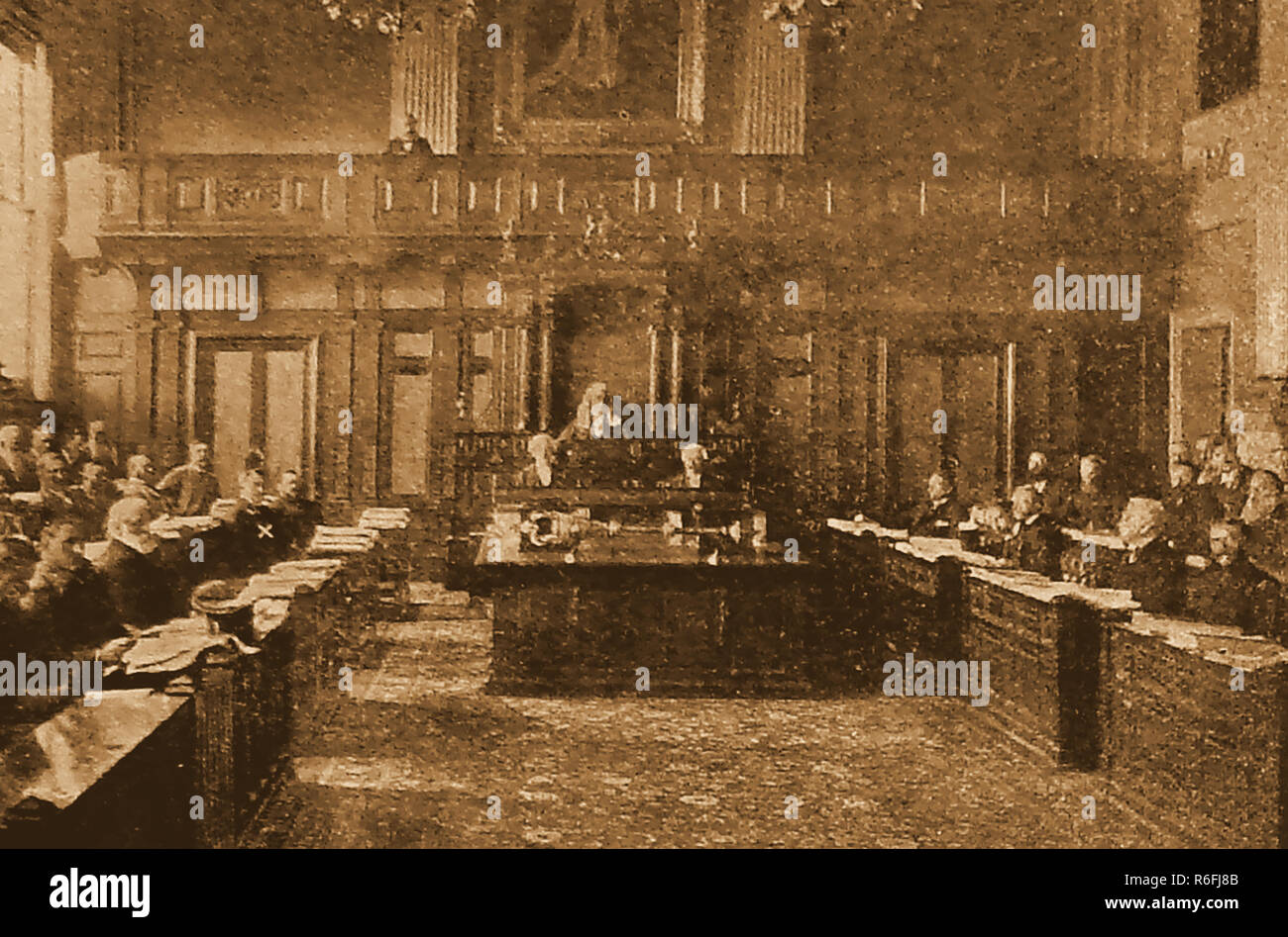 An early photograph, of a sitting of the Cape Parliament  aka Cape Colony or the Parliament of the Cape of Good Hope(South Africa) in the late 1800's. CECIL RHODES is in the chamber (marked with a white cross on the left) - Stock Image