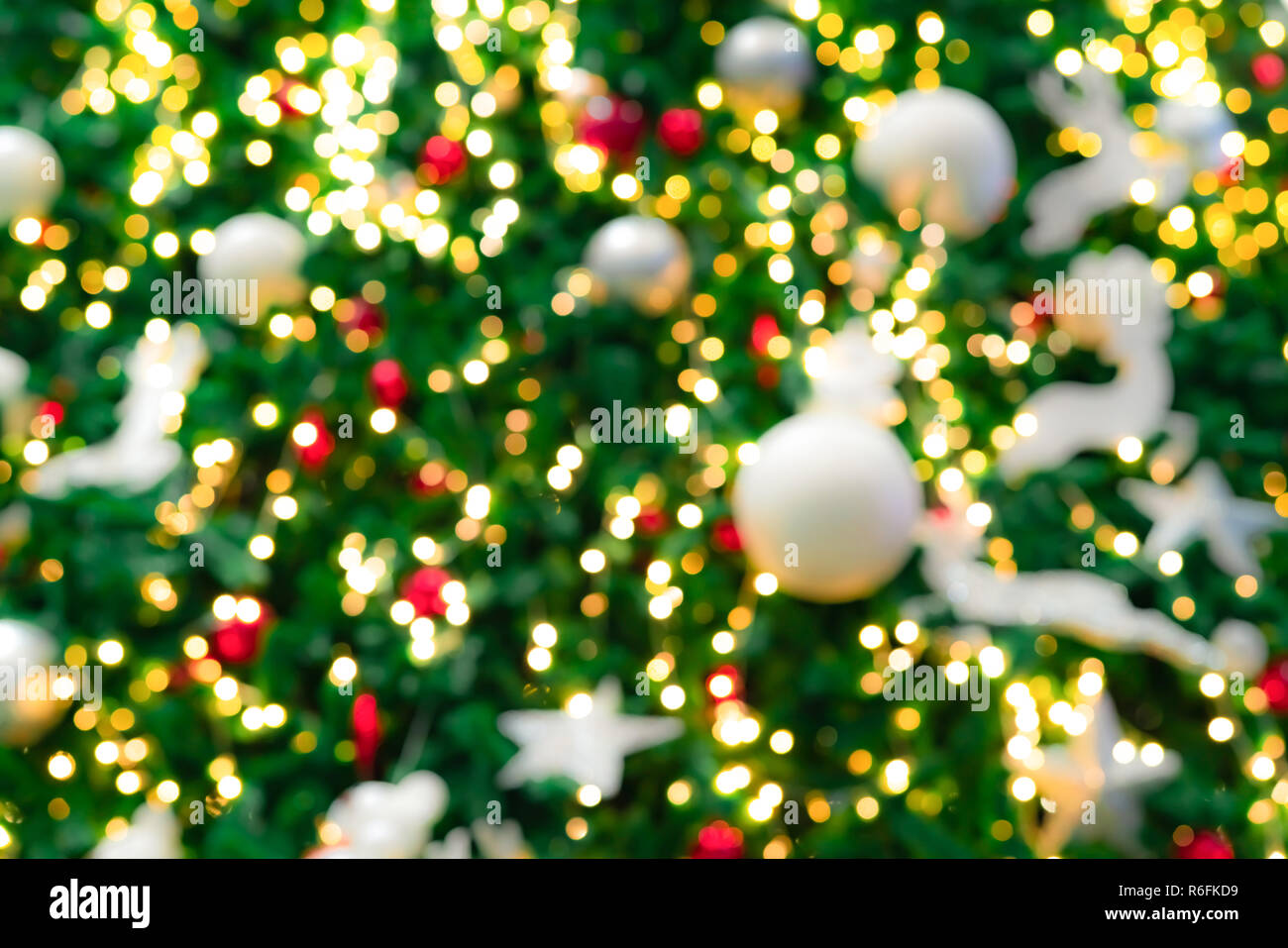 Blurred Red Green And Gold Bokeh Background Of Christmas Tree
