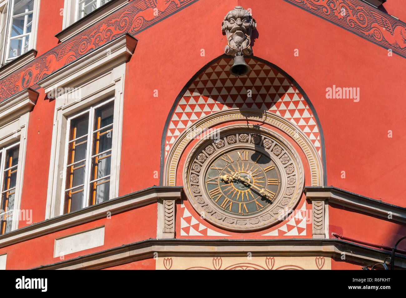 Old Clock On The Wall At The Market Square In The Old Town Of Warsaw, Poland - Stock Image