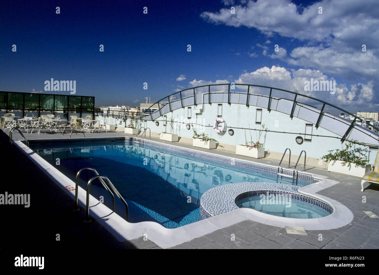 Swimming pool blue clean water and stainless steel railings