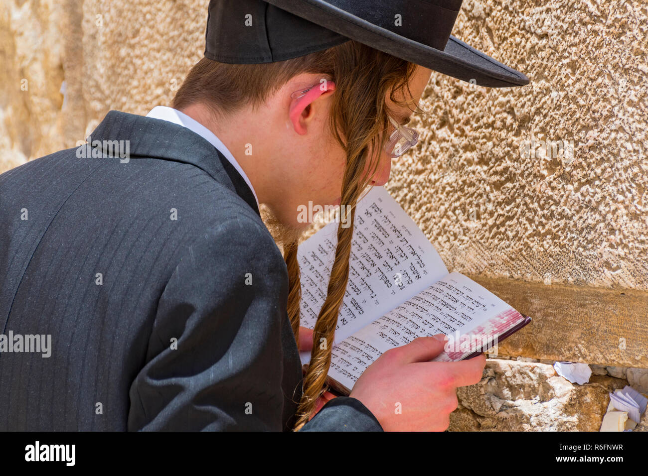 Religious Orthodox Jew Praying At The Western Wall In Jerusalem Old City, Israel - Stock Image