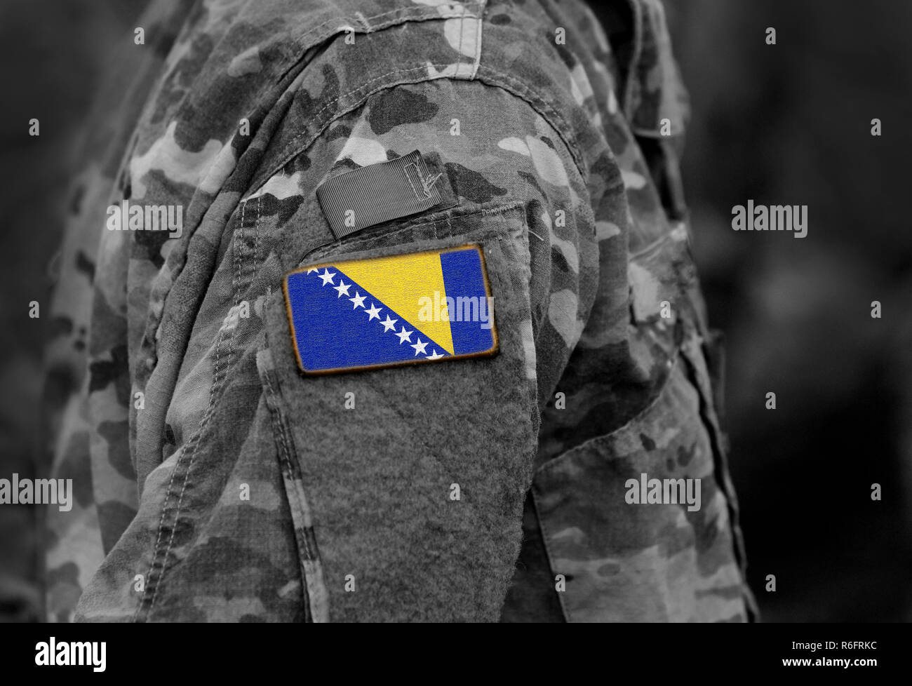 Flag of Bosnia and Herzegovina on soldiers arm (collage). Stock Photo