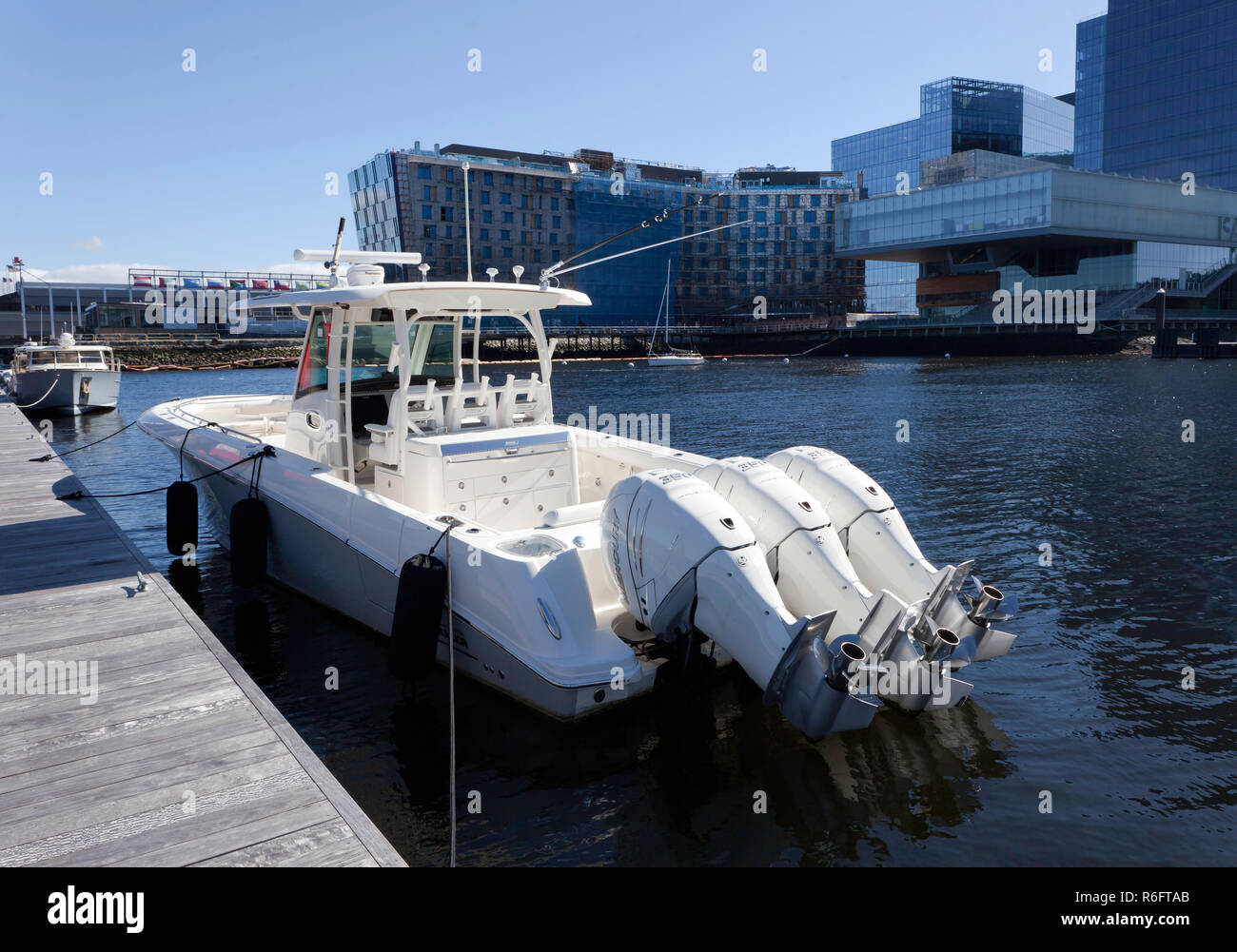 A Boston Whaler 350 Outrage moored in the South Bay Harbour,  near  the Institute of Contemporary Art, Boston - Stock Image