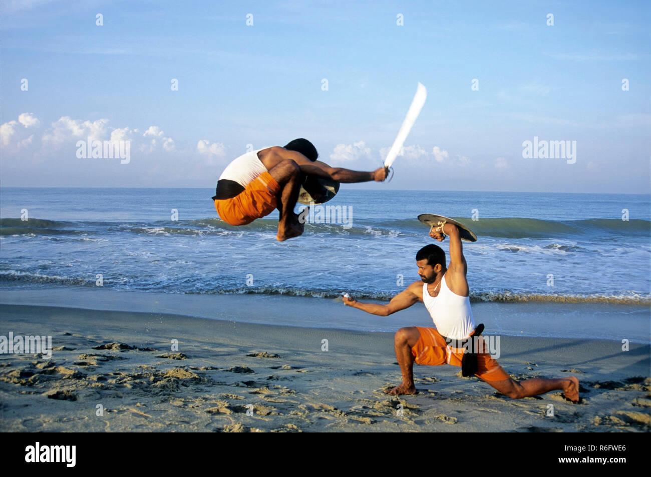 Kalarippayattu, Swords and shields fighting, Ancient Martial Art of Kerala, India MR#299 - Stock Image