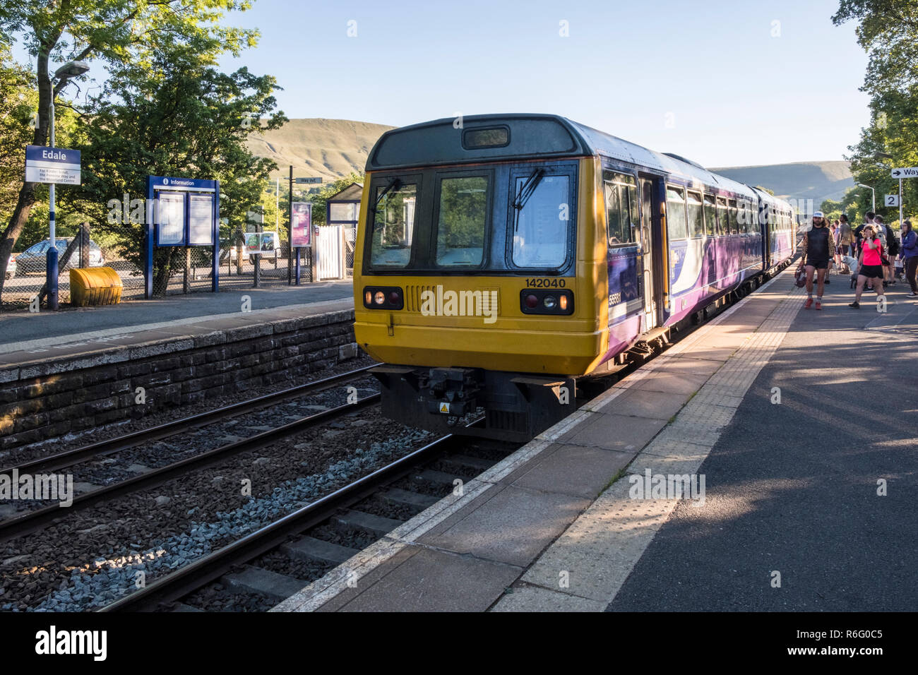 Northern Rail train arriving at Edale Railway Station on a Summer evening, Edale, Derbyshire, Peak District, England, UK - Stock Image