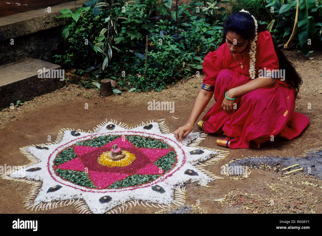 floral decoration in the front yard of every house during onam festival, kerala, india - Stock Image