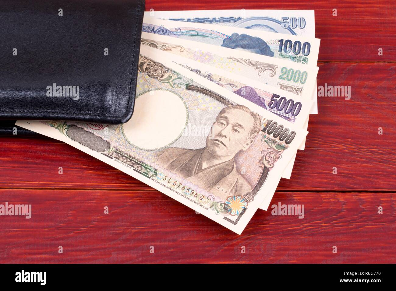Japanese money in the black wallet - Stock Image
