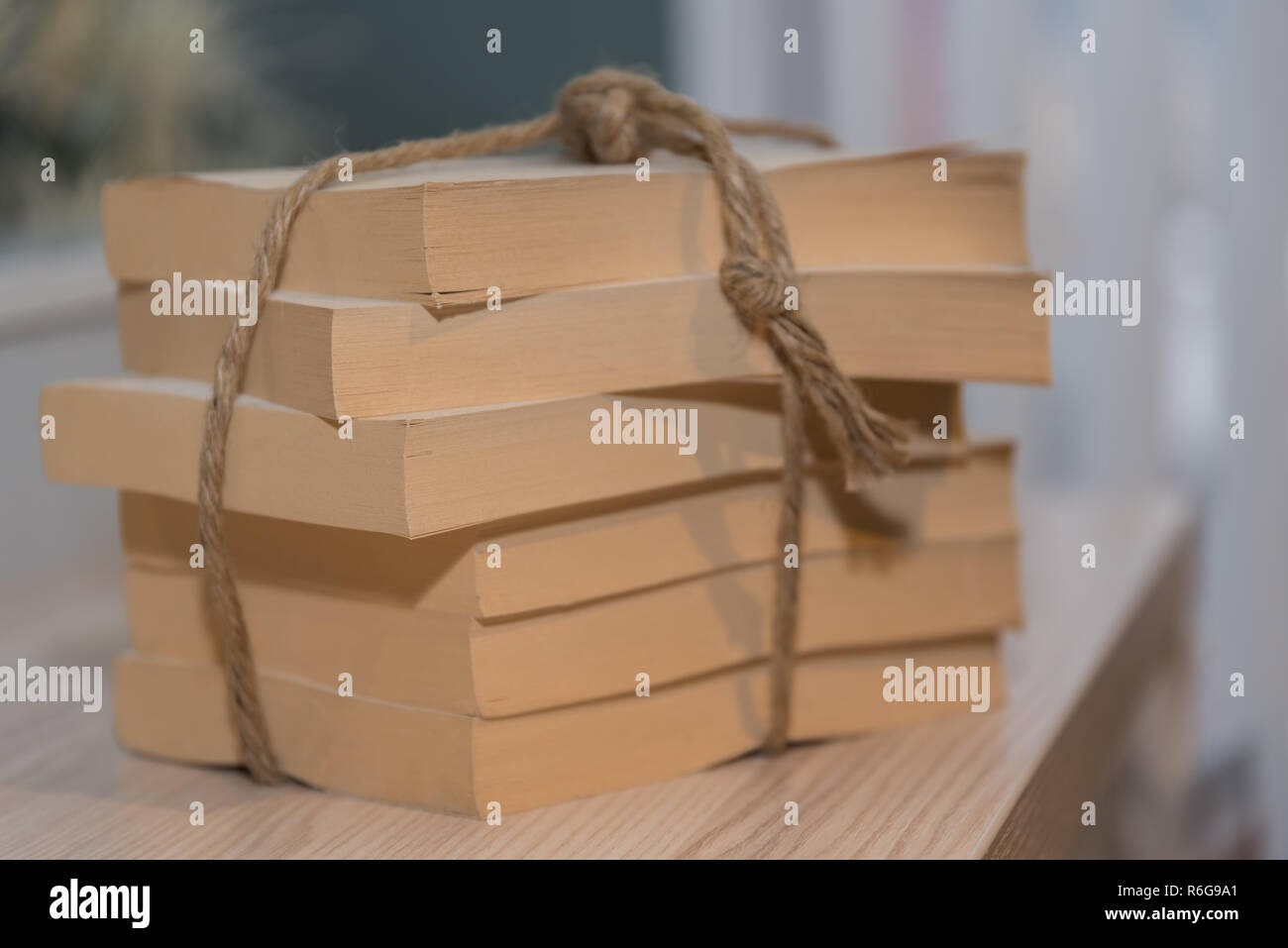 paperbacks tied to stacks - Stock Image