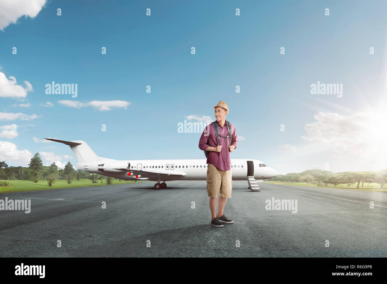 Handsome asian traveler with backpack ready to depart - Stock Image
