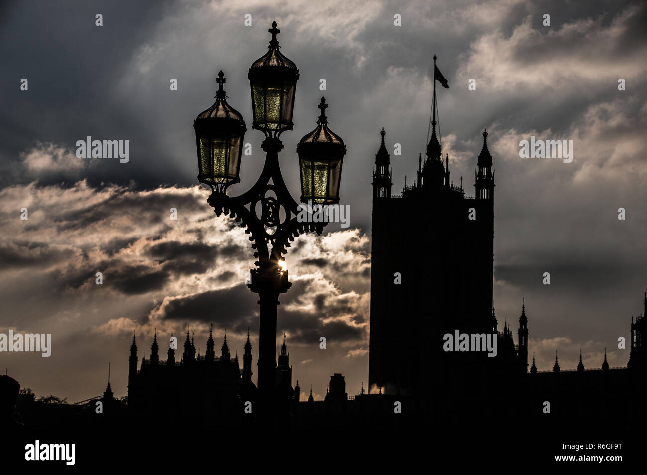 Dark skies at dusk sit over The Houses of Parliament, Westminster, London, United Kingdom - Stock Image