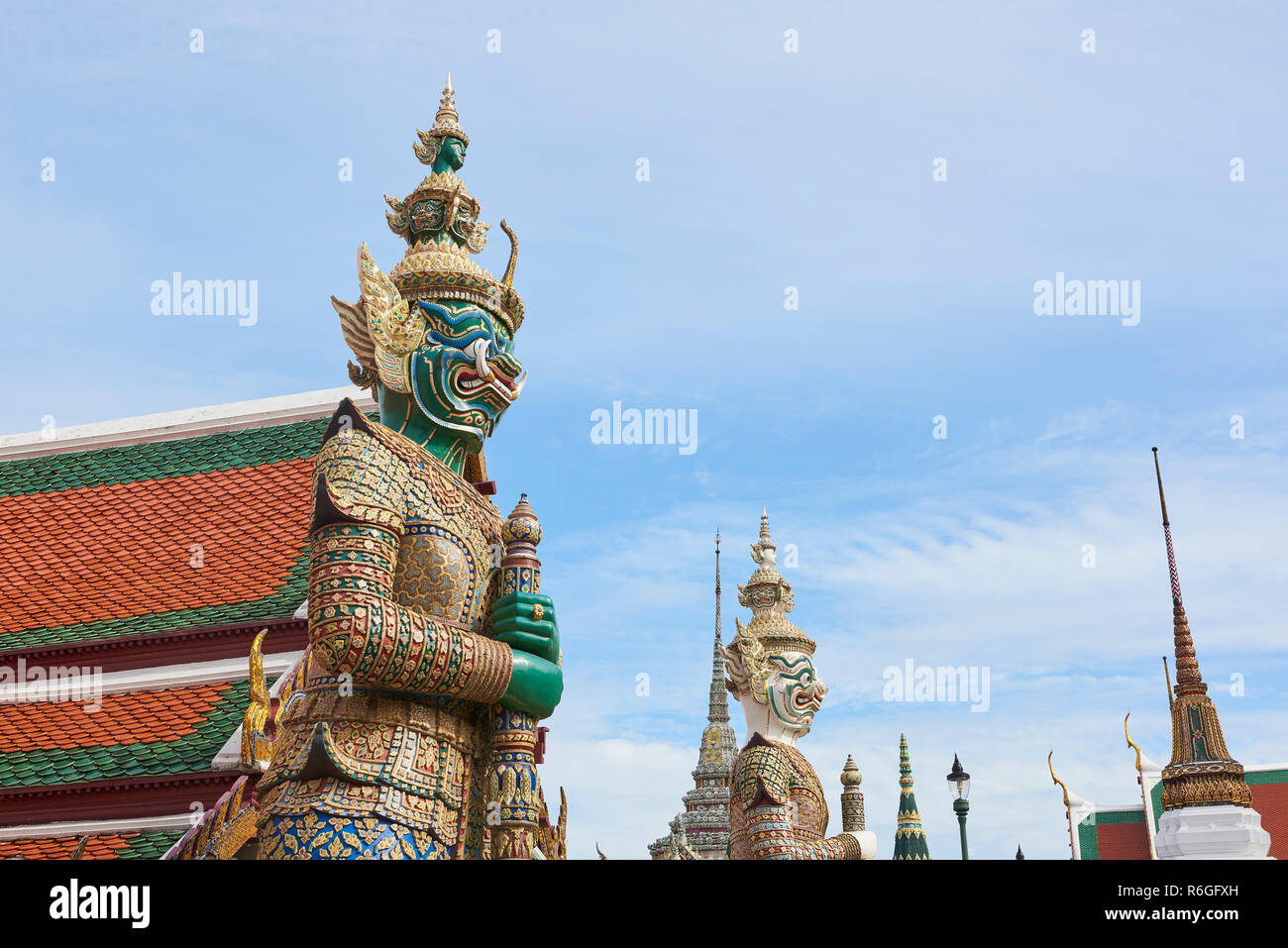 Yaksha statue in the Grand Palace in Bangkok, Thailand. The demon-gods statues are a common sight in Buddhist temples in Thailand, but also feature in Stock Photo