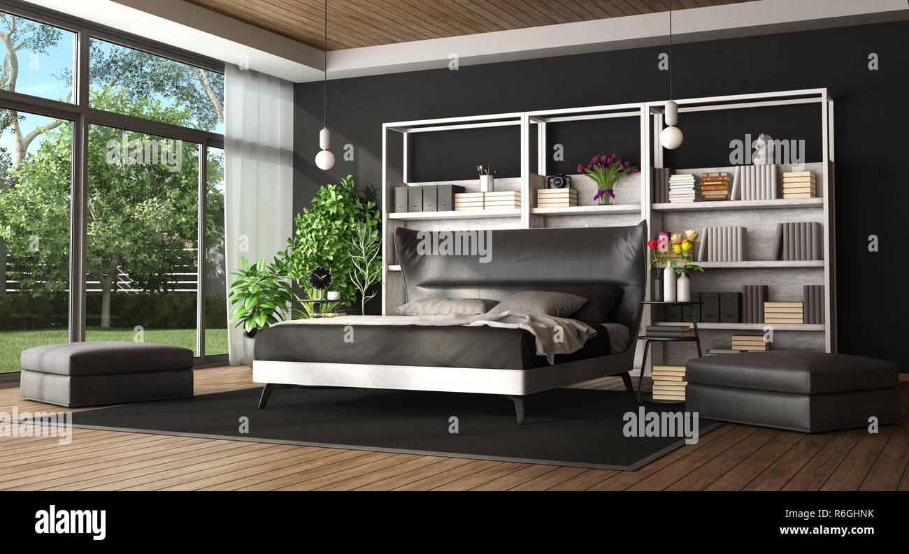 Master bedroom in a modern villa with black and white bed ...