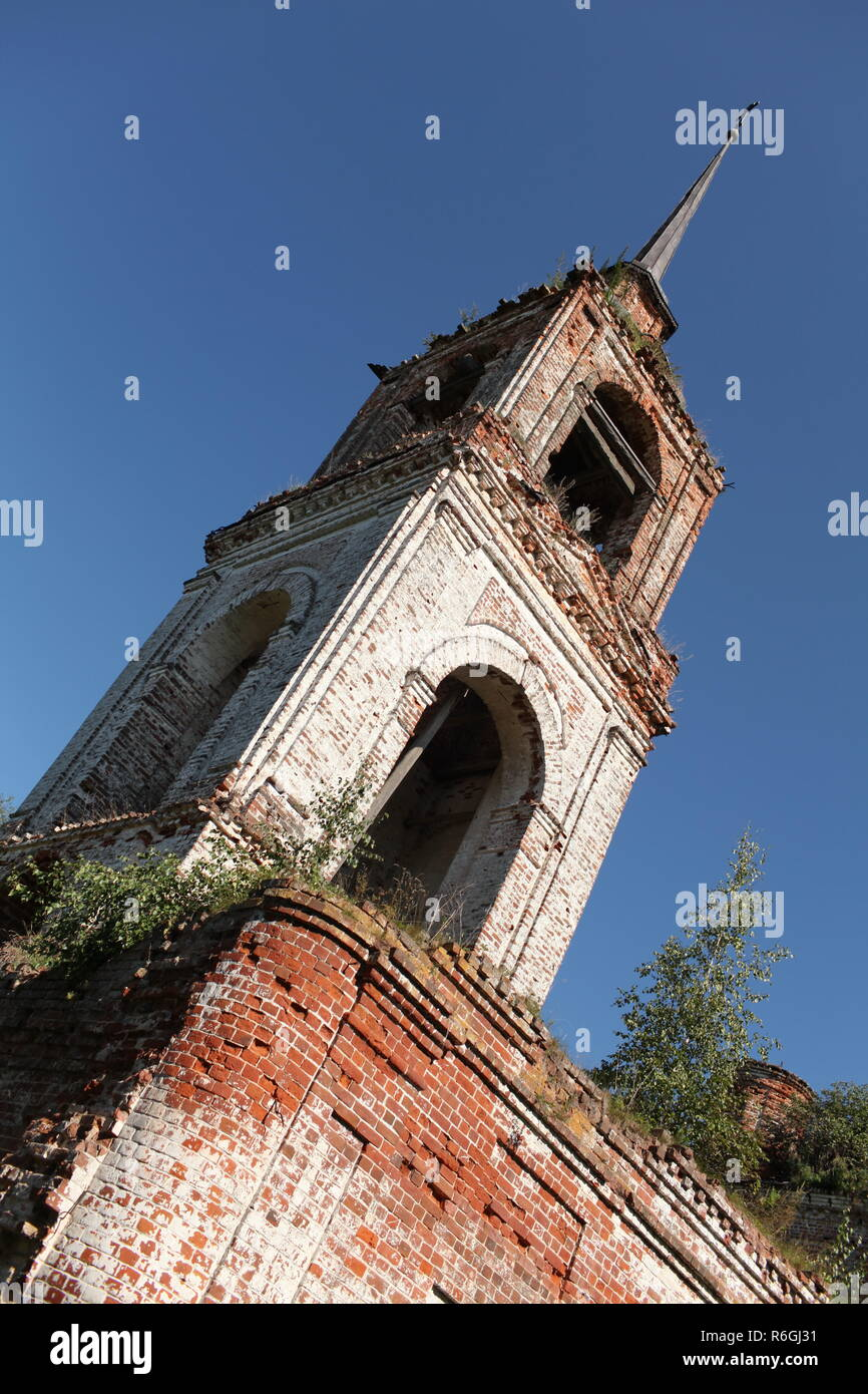 Ruined temple, falling bell tower, the concept of loss of faith - Stock Image