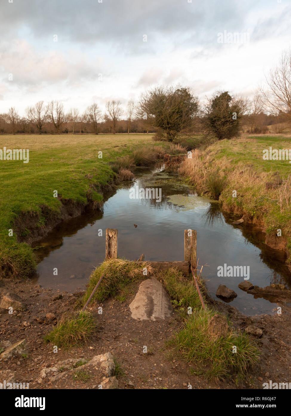 wet waterlogged country farm land stream eddy Stock Photo