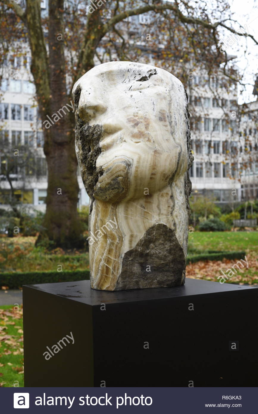 Emily Young - 'Lost Mountain Head 1' St. James's Square, central London, England, UK. Emily Young is a British sculptor known for her meditative, figu - Stock Image