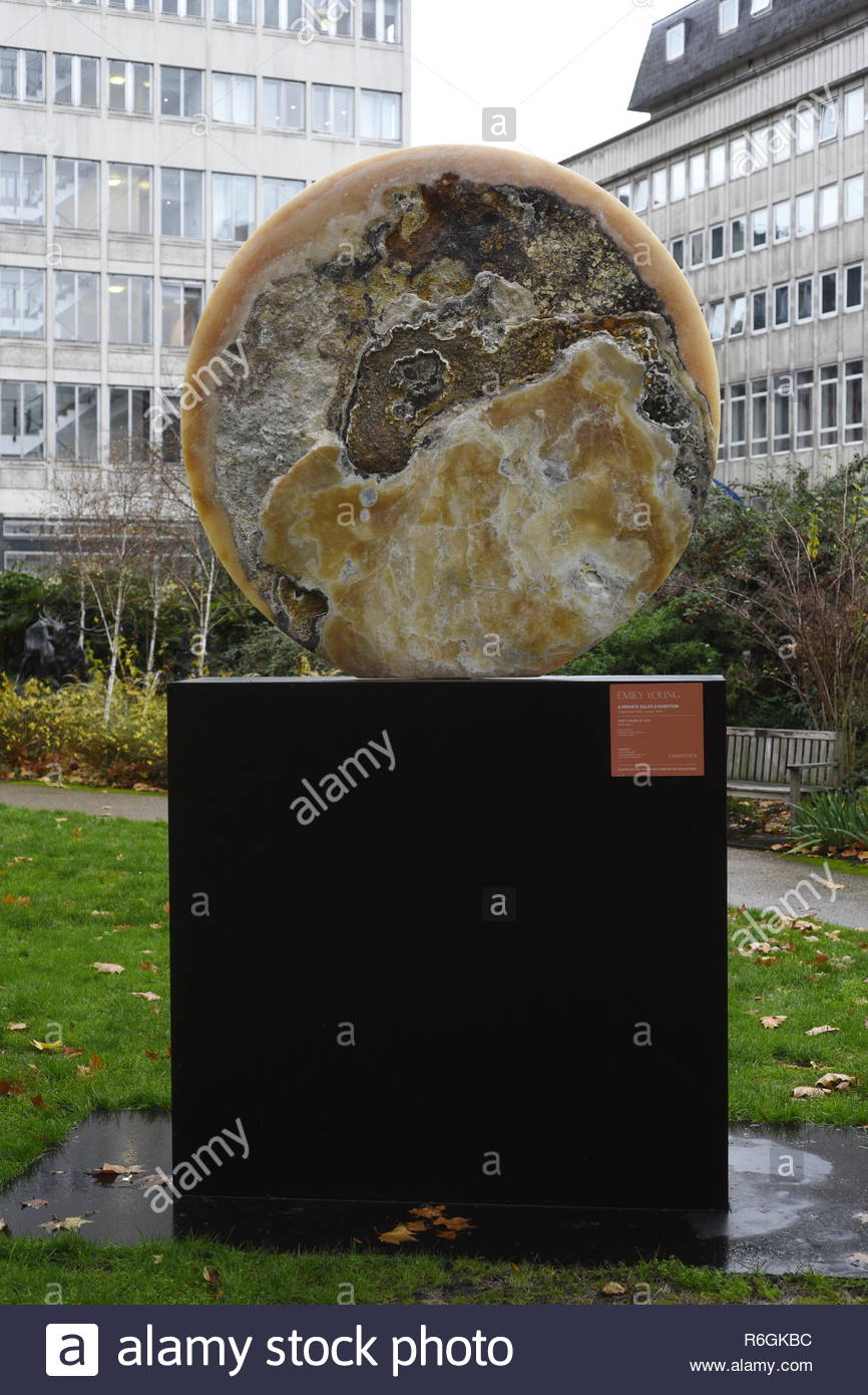 Emily Young - 'Solar Disc 1' St. James's Square, central London, England, UK. Emily Young is a British sculptor known for her meditative, figurative work - Stock Image