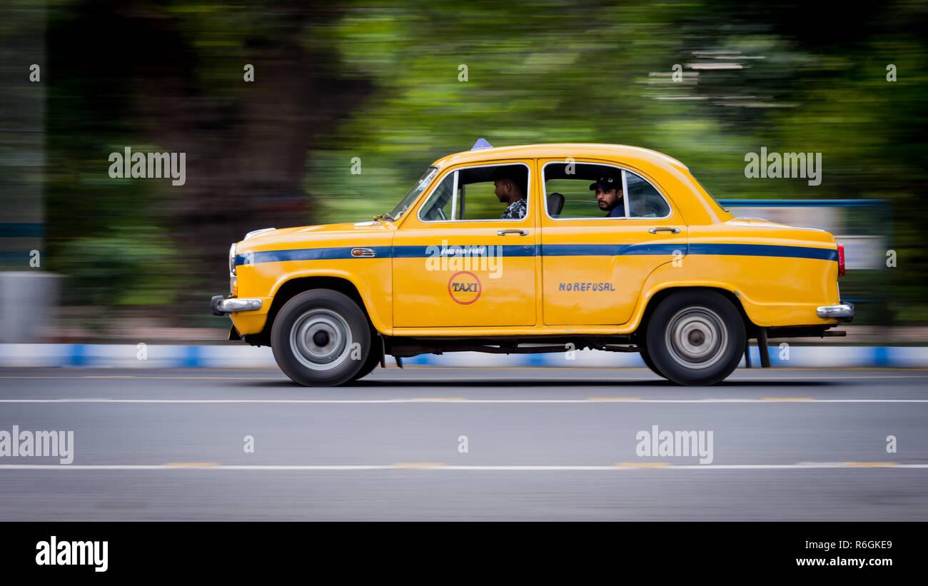 Kolkata, India - November 18th 2018: Iconic yellow taxi at Calcutta ( Kolkata ) India. The Ambassador taxi is no more built by Hindustan Motors - Stock Image
