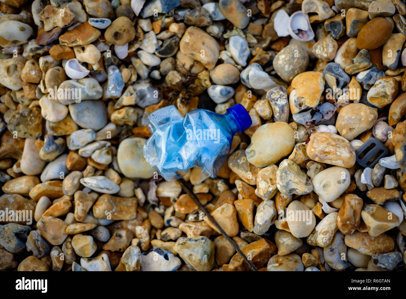 Beach pollution, plastic and waste from the ocean on a beach. - Stock Image