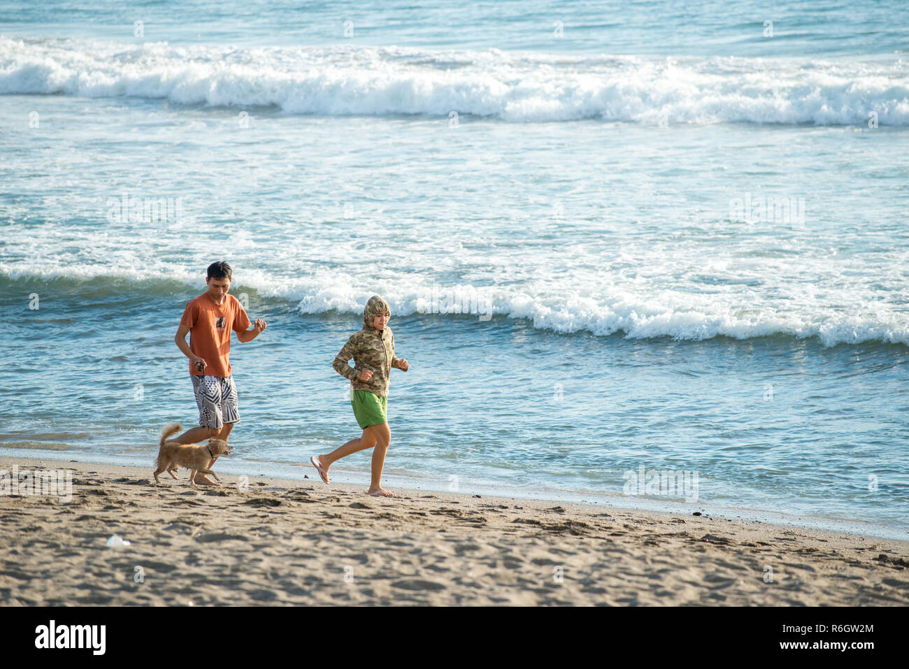 Tourists Enjoy A Bali Vacation Running On The Beach Bali Is Popular