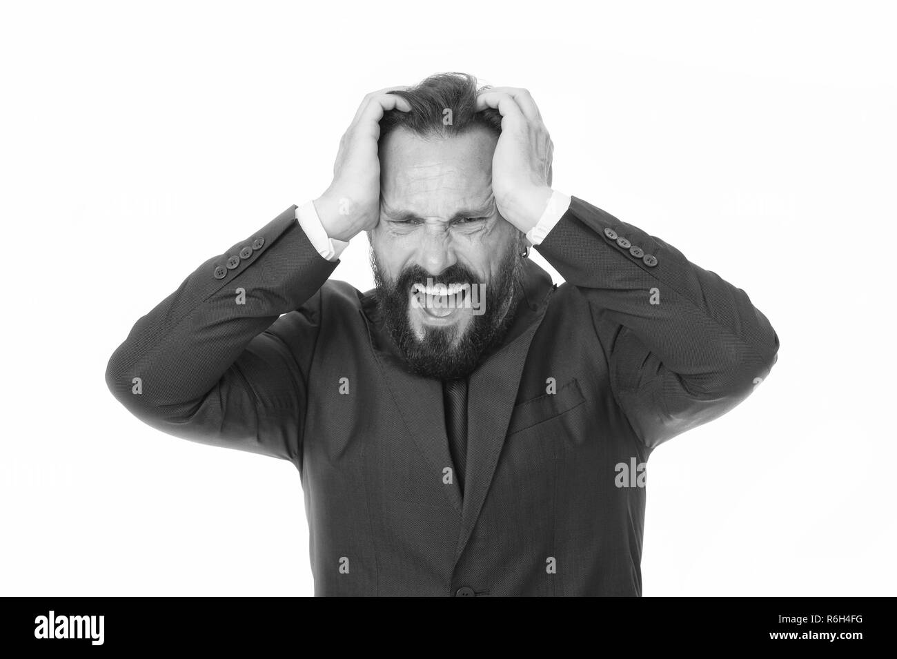 Failed again. Frustrated business man hold hands on head and keep eyes closed while stand against white background. Businessman feel pain headache stressful day. Stressful business life. - Stock Image