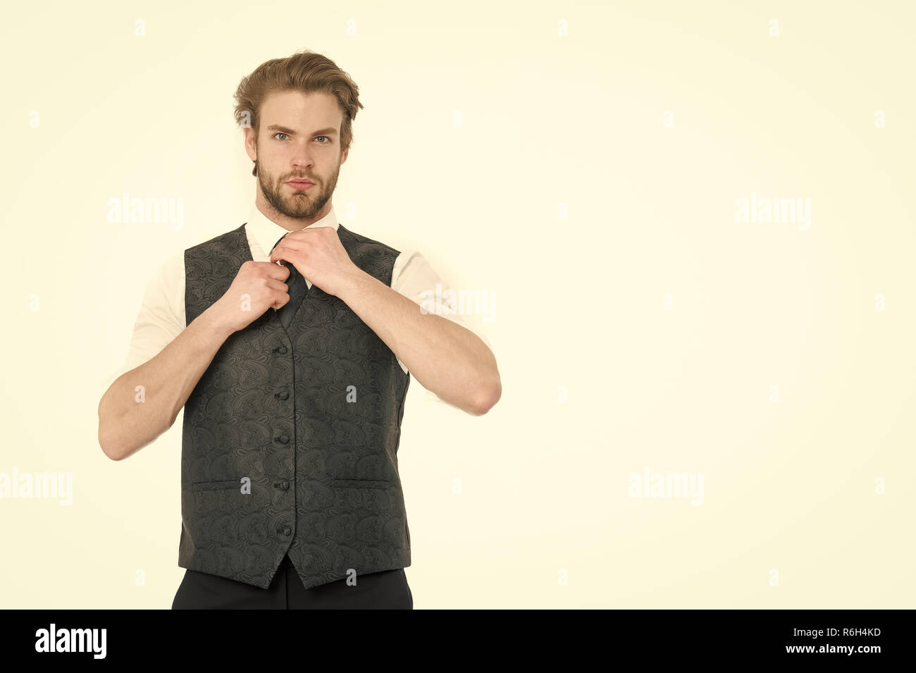 An elegant bearded business man in waistcoat isolated on white background, copy space - Stock Image