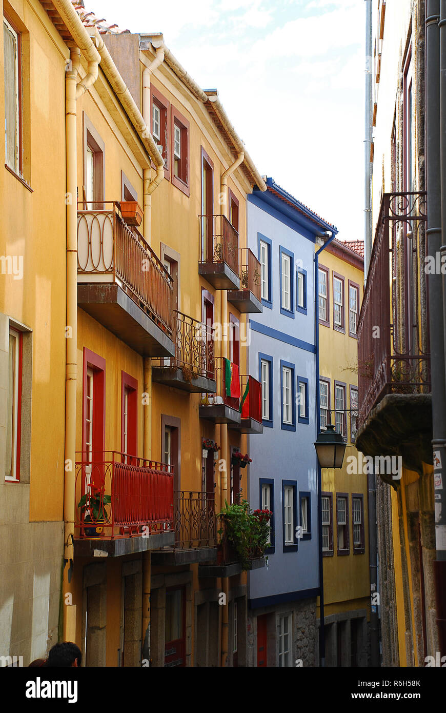 Typical colored house facades in Porto, Portugal. Porto is the second-largest city in Portugal after Lisbon - Stock Image