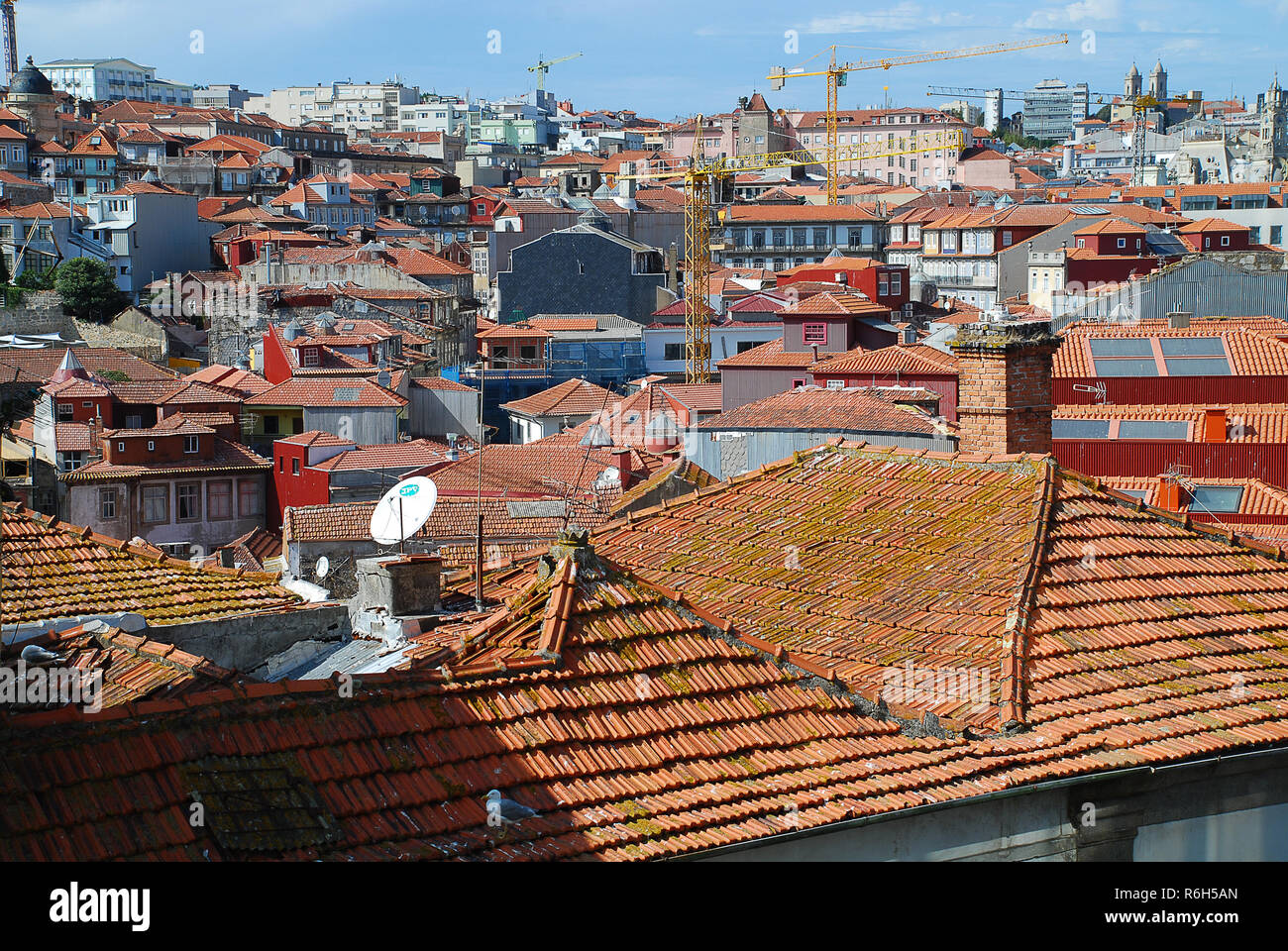 Colored facades and roofs of houses in Porto, Portugal. - Stock Image