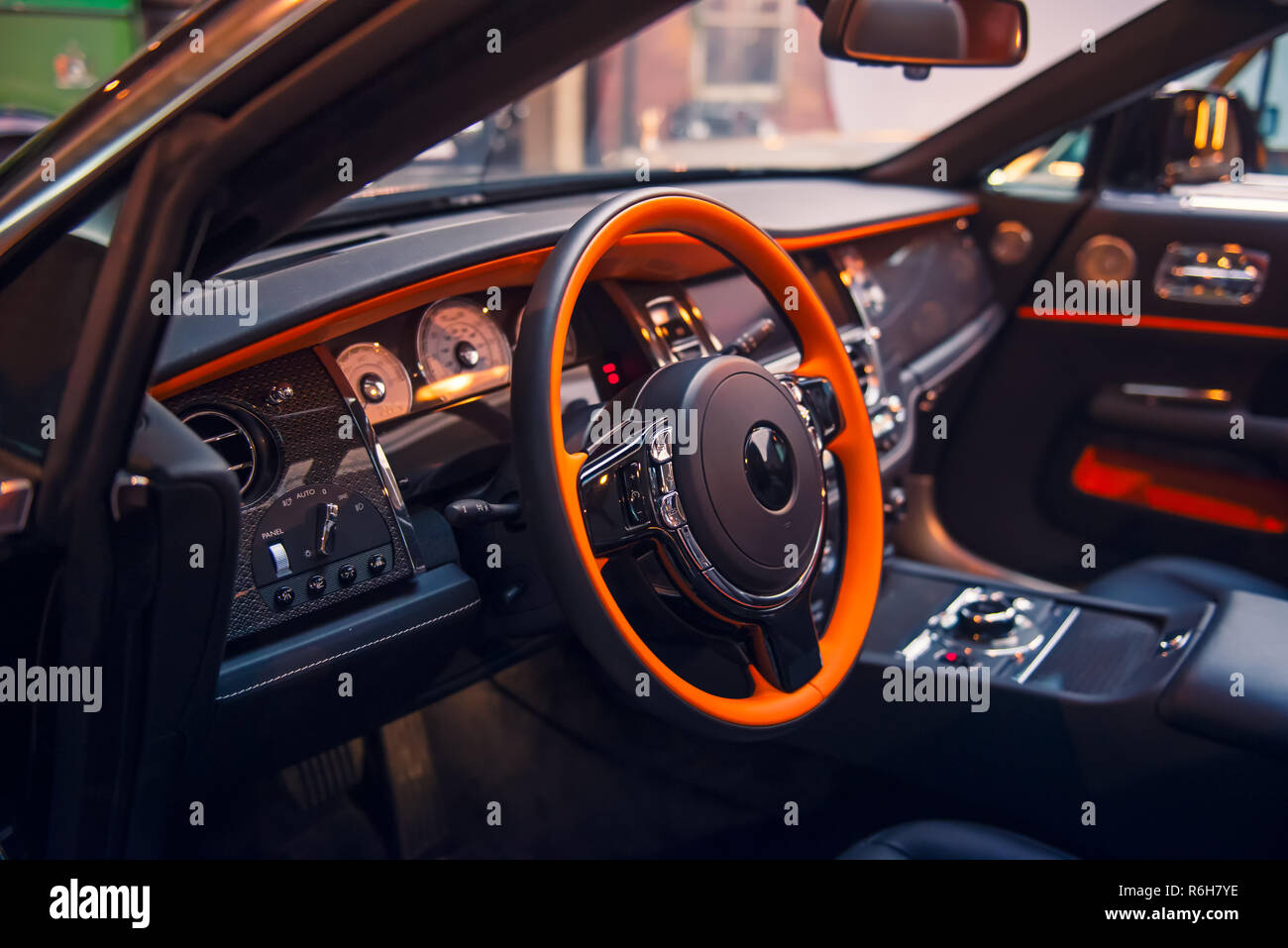 Close up Luxury convertible car interior. Steering wheel, shift lever and dashboard. Driver side view. Selective focus, copy space - Stock Image