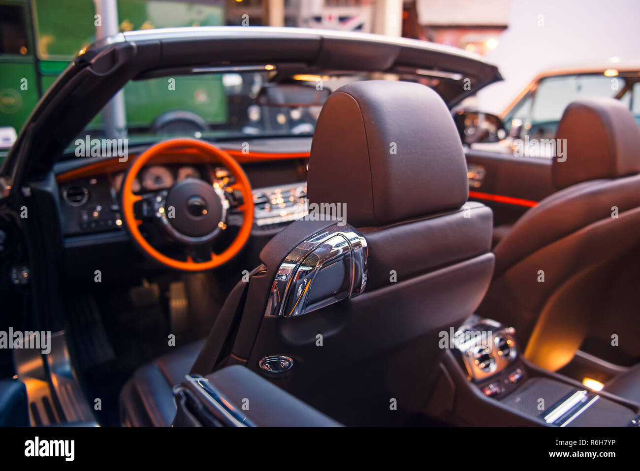Luxury convertible car interior. Steering wheel, shift lever and dashboard. Driver side view. Selective focus, copy space - Stock Image