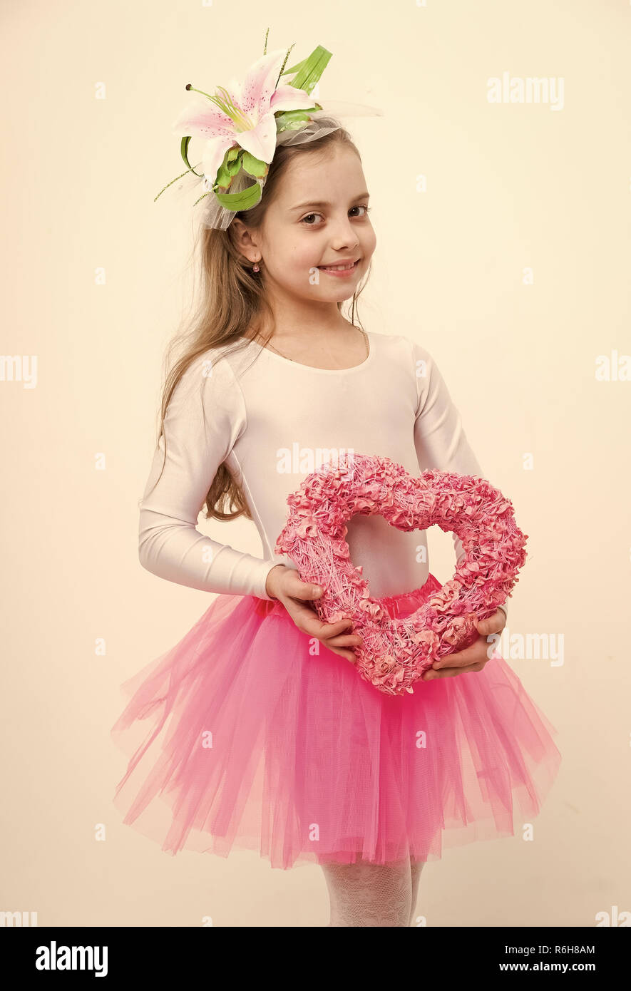701fd5db7c small baby girl dancer, cute child ballerina with happy face and lily  flower in blonde