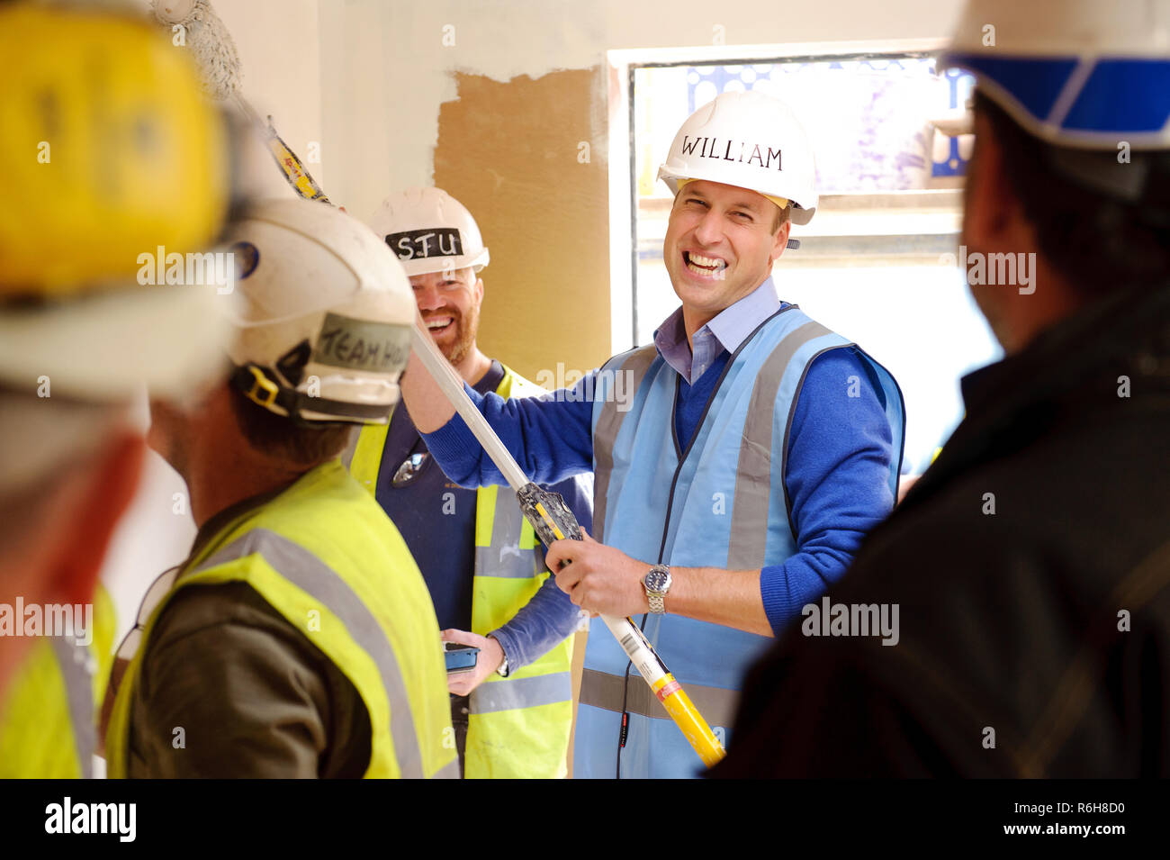 Prince William, Duke of Cambridge, pictured meeting tradesmen on the BBC's DIY SOS project in Manchester. - Stock Image