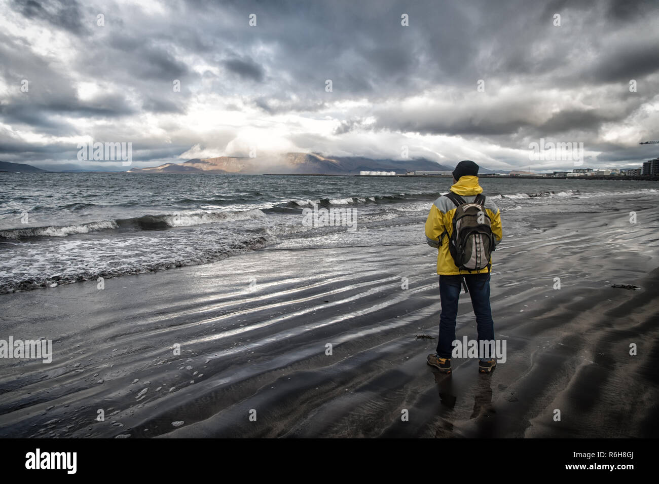 Tourist well equipment ready explore scandinavian or nordic country. Tourist on sea background. Man tourist wear warm protective clothes for cold climate conditions. Tourist traveller concept. - Stock Image