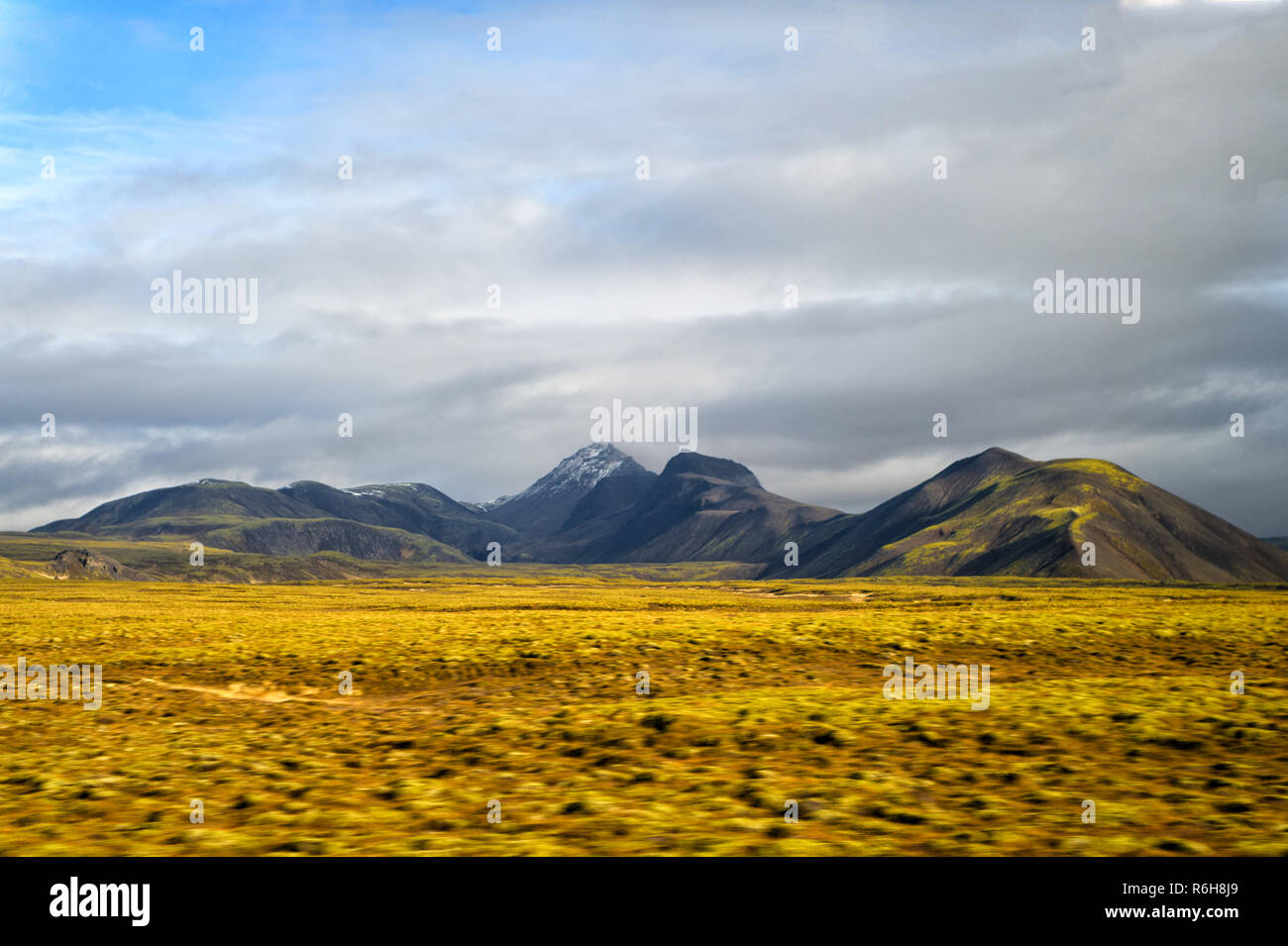 Highlands of Iceland concept. Haukadalur valley in Iceland. Beautiful landscape in valley. Peaceful nature environment. Valley landscape sunny autumn day cloudy sky. Amazing beauty of valley. Stock Photo