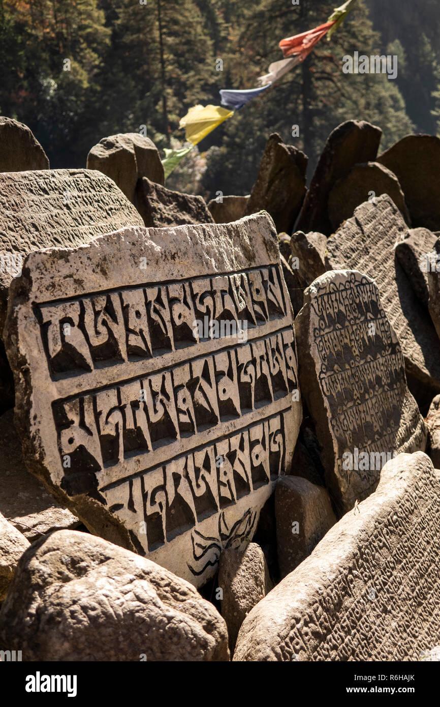 Nepal, Jorsale (Thumbug), carved, painted Buddhist mani stones and prayer flags - Stock Image