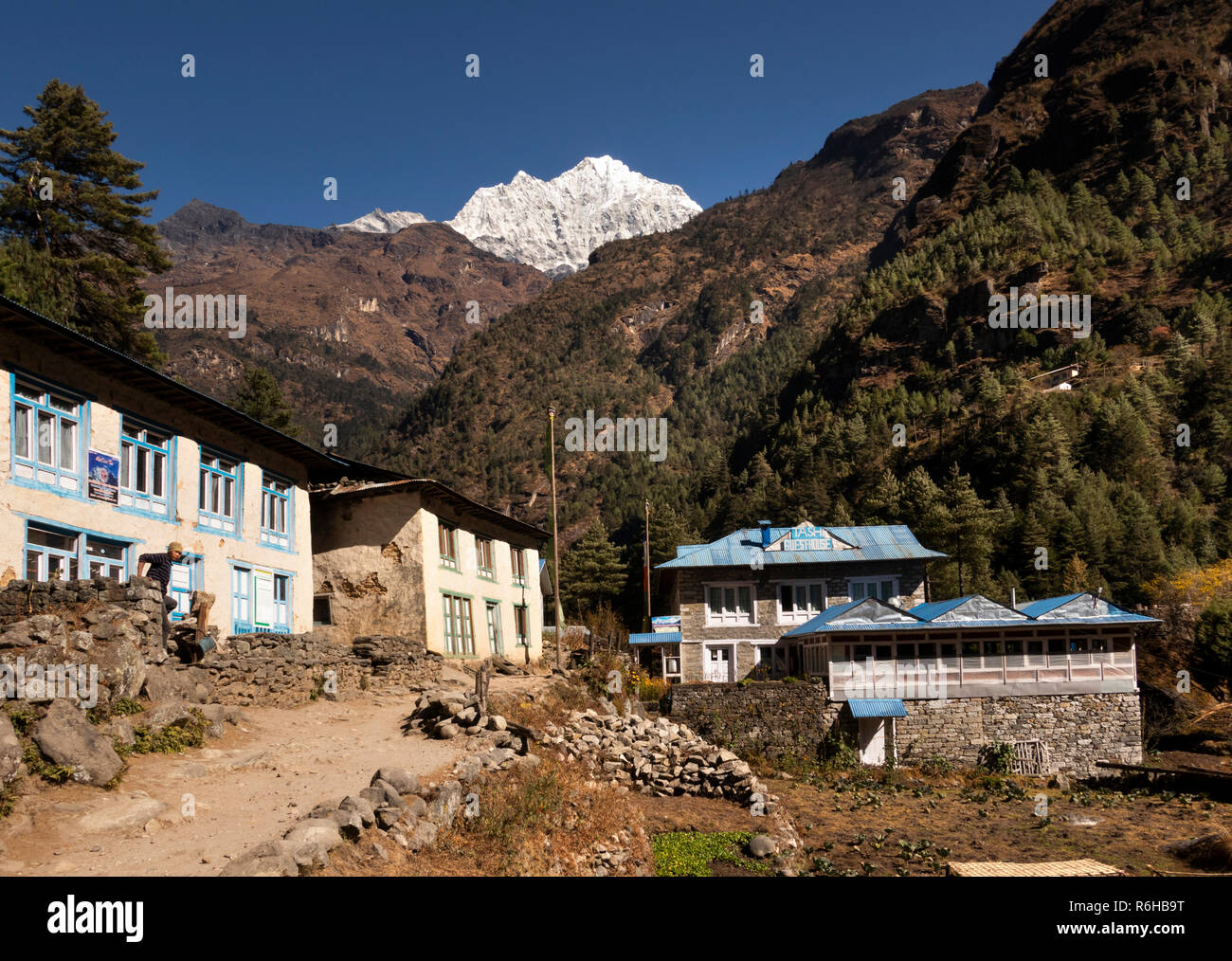 Nepal, Benkar, small local guest houses beside Everest Base Camp Trek path below Mount Kusum Kangkaru - Stock Image