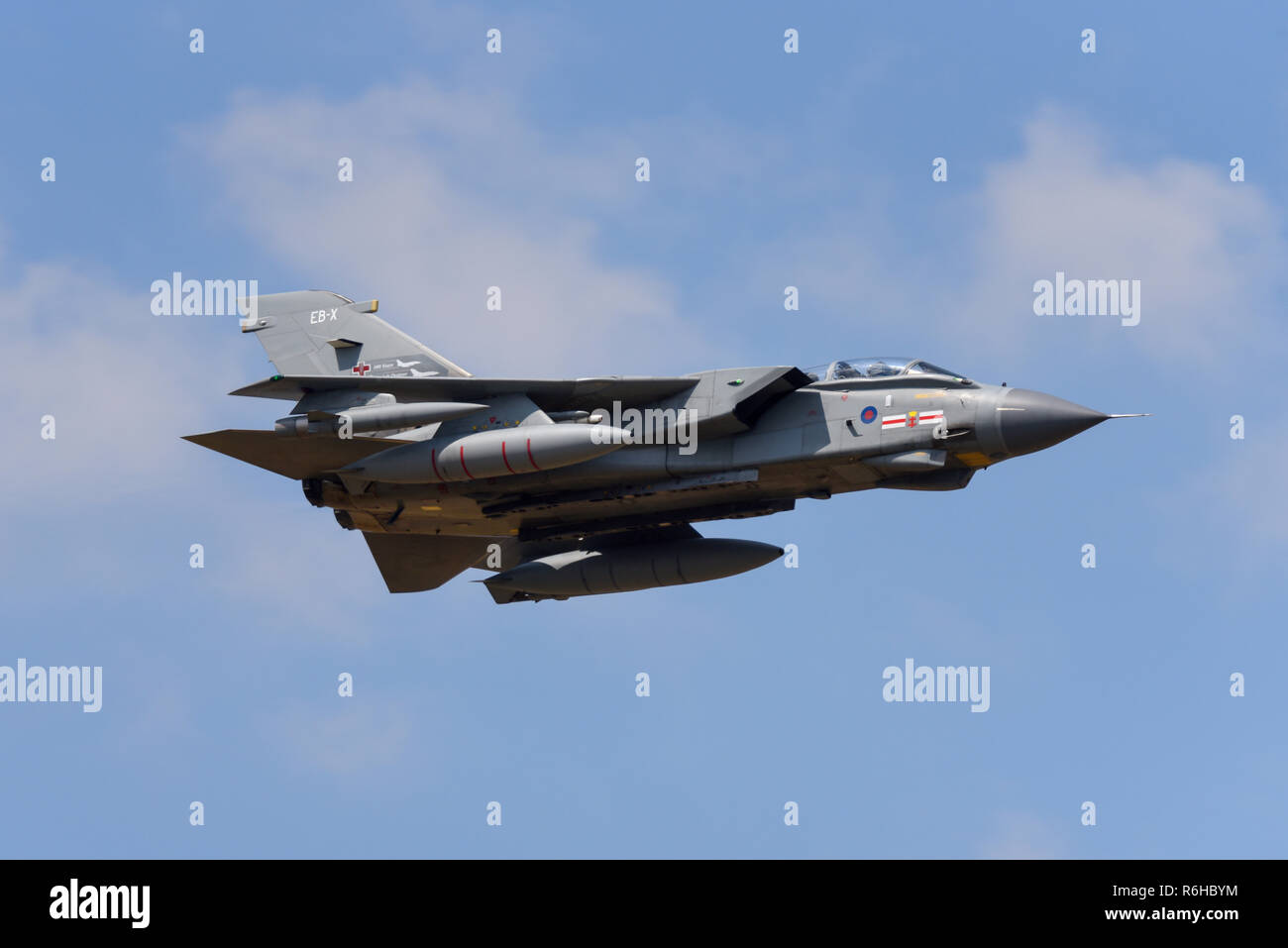 Royal Air Force RAF Panavia Tornado GR4 jet fighter bomber plane flying at Royal International Air Tattoo, RIAT, RAF Fairford airshow. Fast. Speed - Stock Image