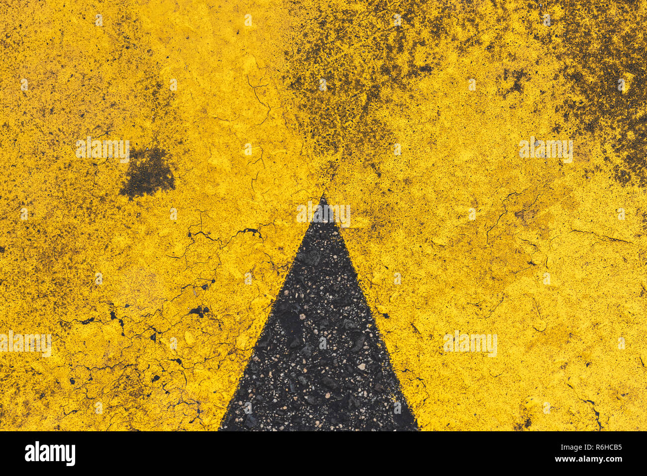 Yellow markings on surface of asphalt road as background - Stock Image