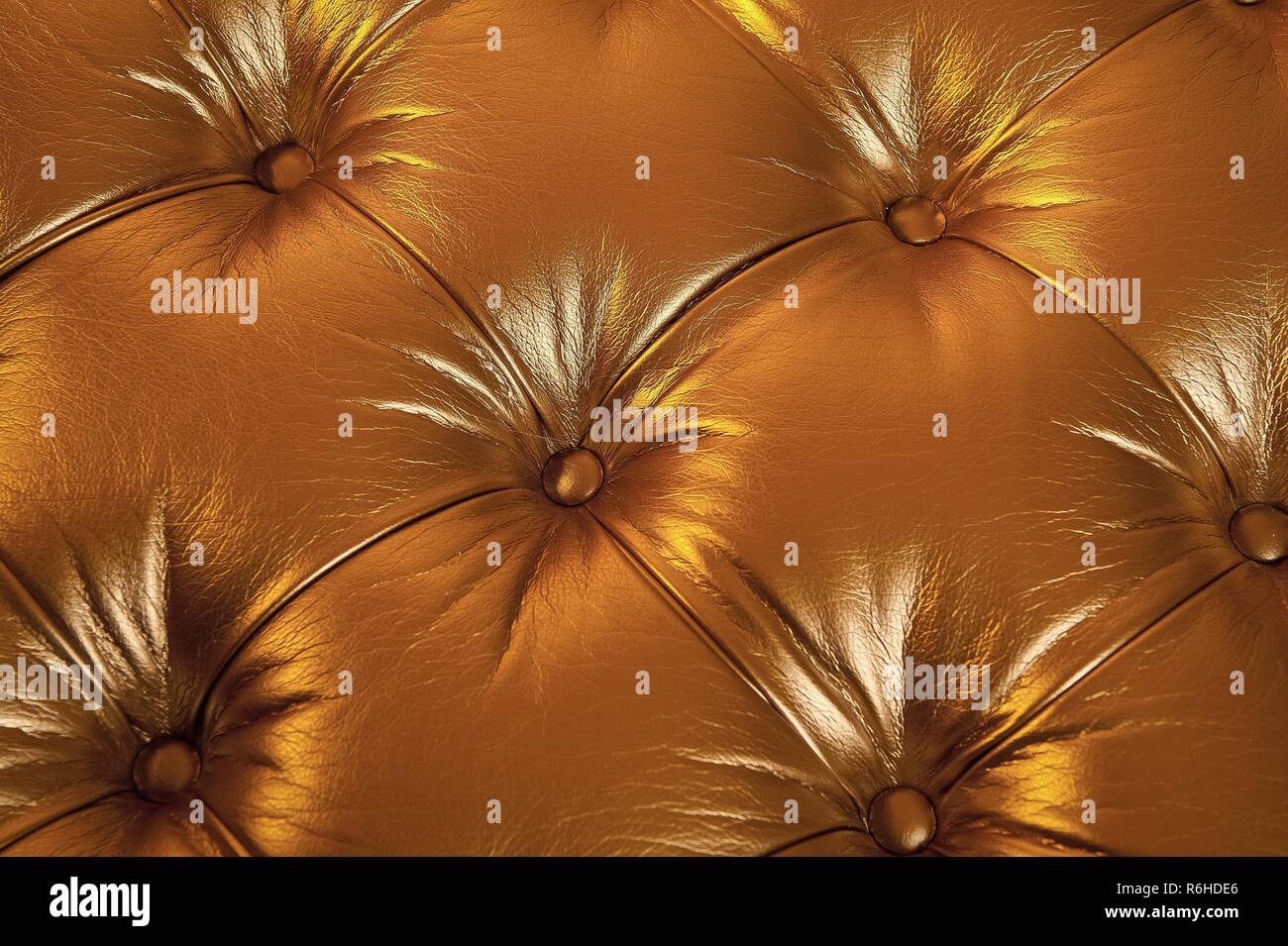 Leather texture padded with buttons on golden background. Furniture, upholstery, decoration, design concept. - Stock Image