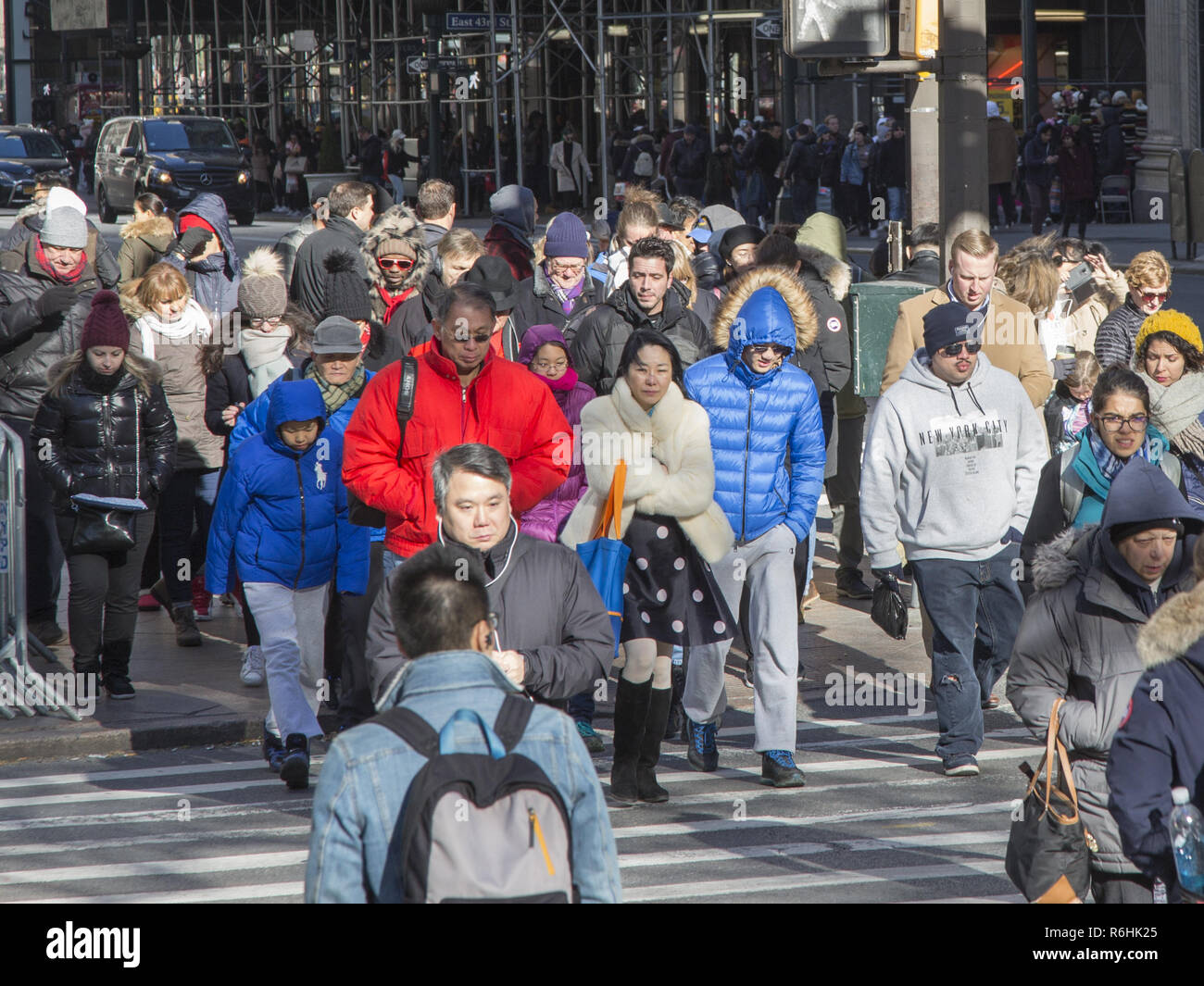 Crowds of people out shopping on a brisk 'Black Friday' at 42nd Street and 5th Avenue kicking off the holiday gift shopping season. - Stock Image