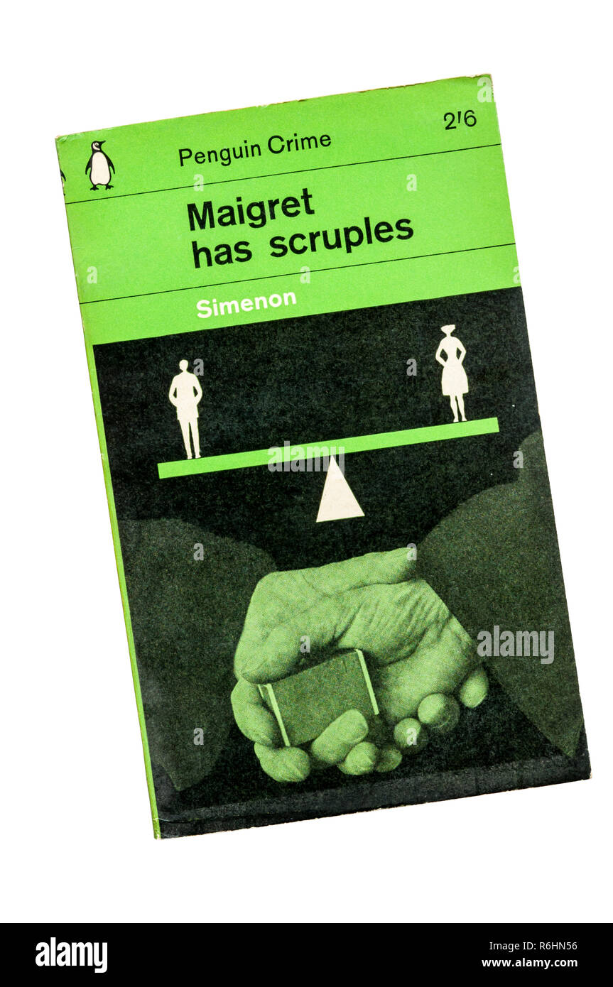 A green paperback Penguin Crime copy of Maigret Has Scruples. First published in French as Les Scrupules de Maigret in 1958. - Stock Image