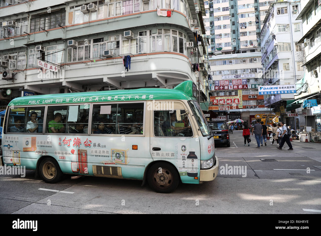 A local minibus transporting passengers through the streets of Kowloon, Hong Kong, The People's Republic of China - Stock Image